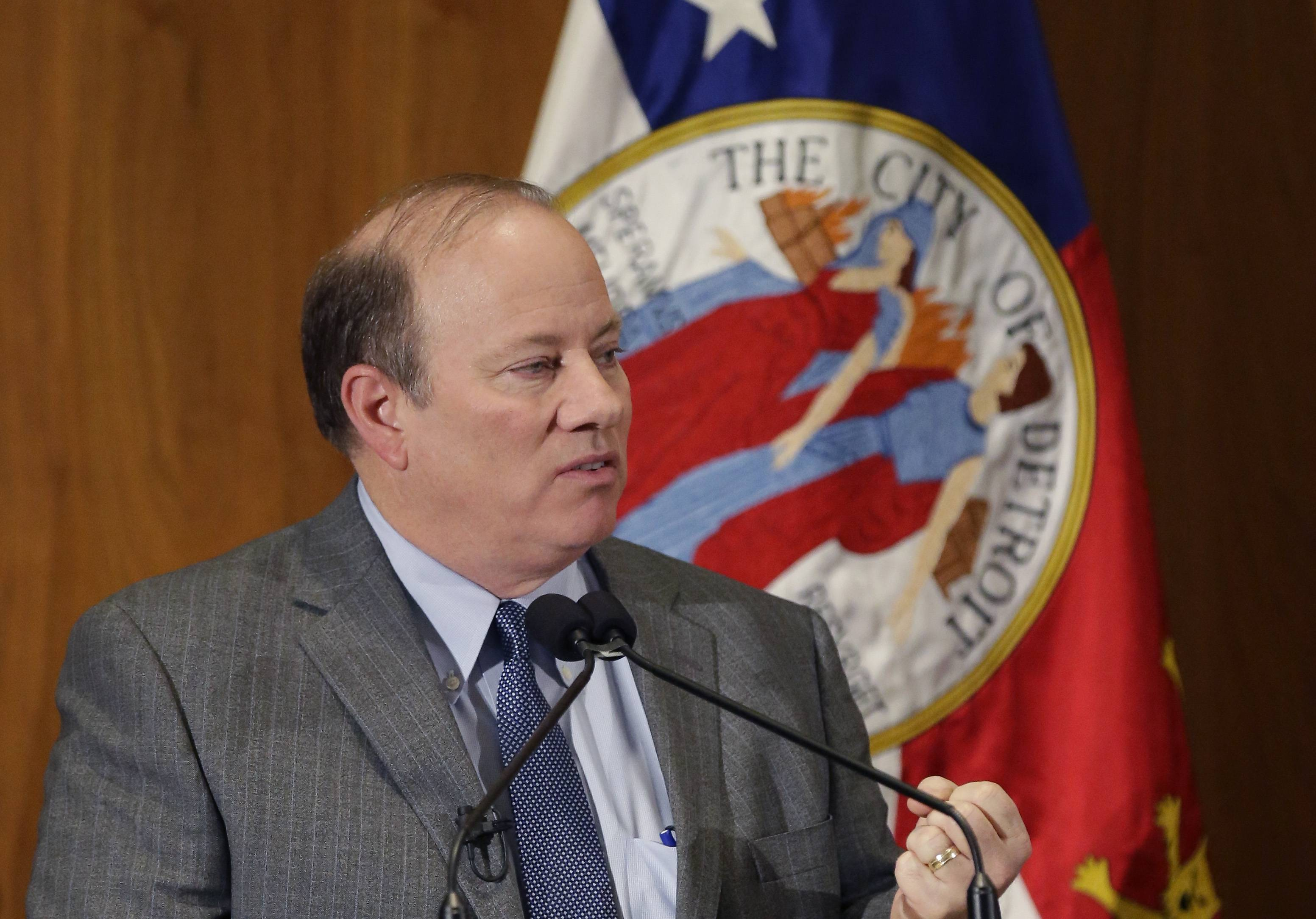 Detroit Mayor Mike Duggan delivers his first State of the City address, Wednesday, Feb. 26, 2014, in Detroit.