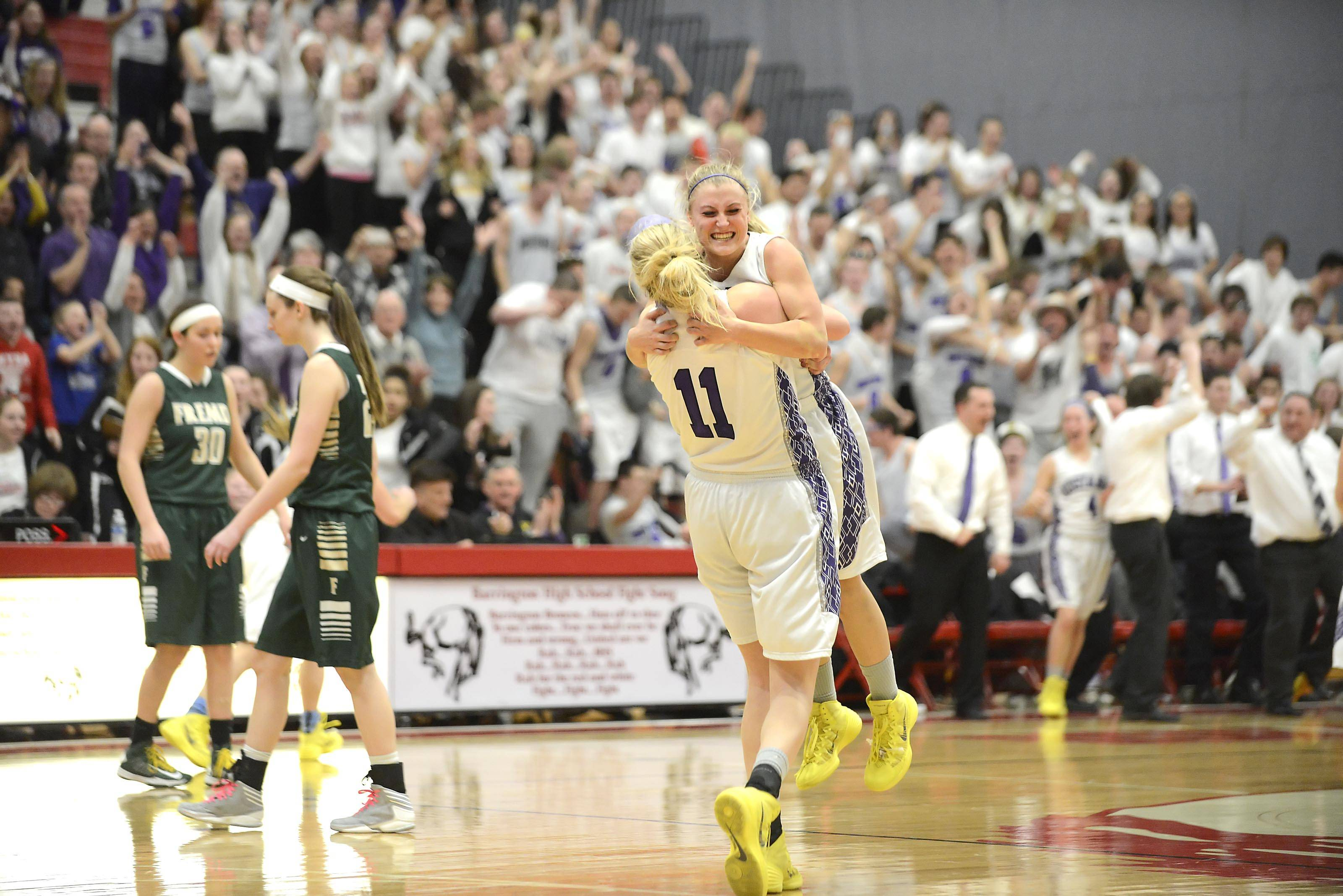 Rolling Meadows' Jackie Kemph is picked up by teammate Jenny Vliet as Fremd's players walk off the floor Thursday after the Barrington sectional championship game.