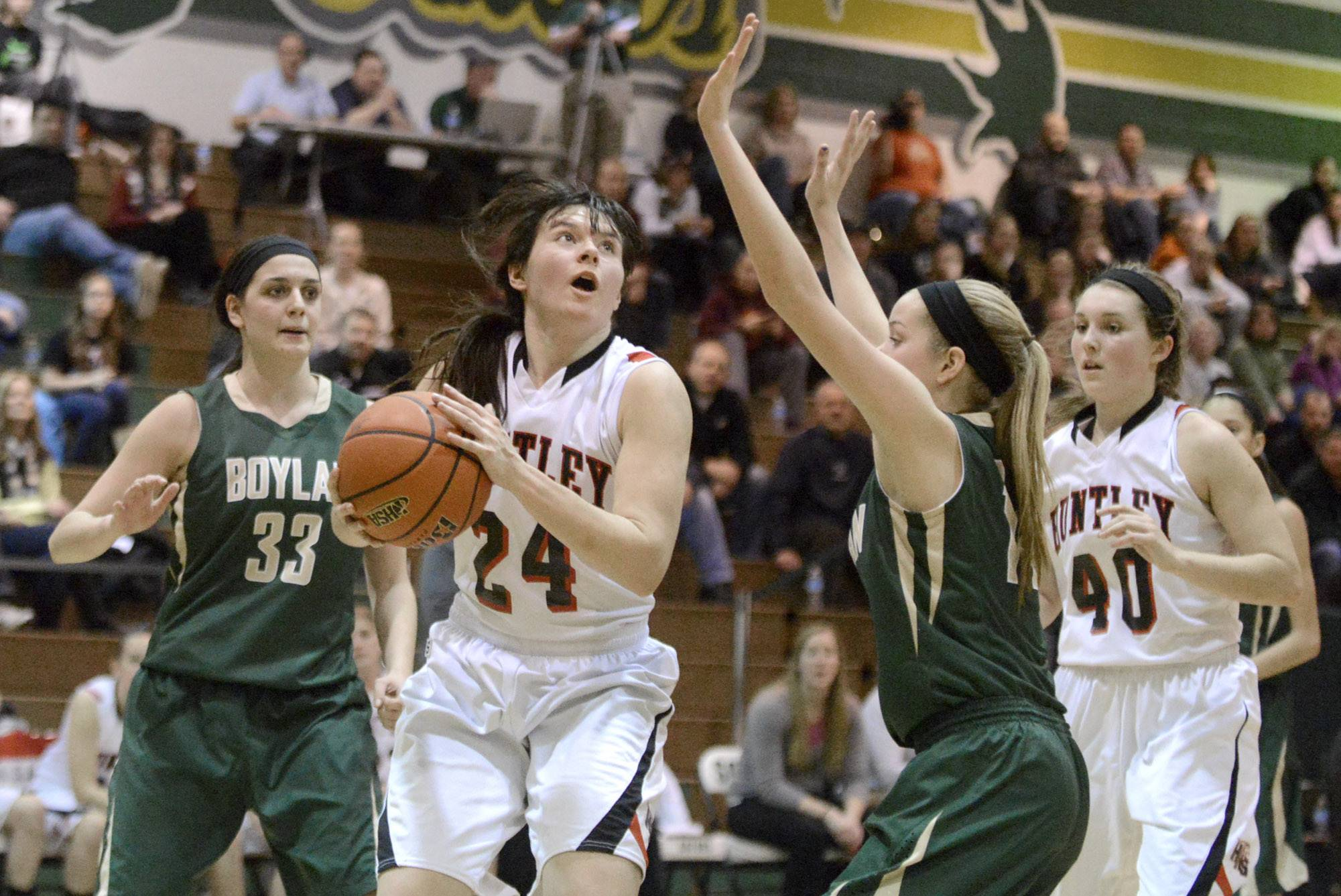 Huntley's Bethany Zornow looks to shoot over a block by Rockford Boylan's Allie Zimmerman in the fourth quarter .