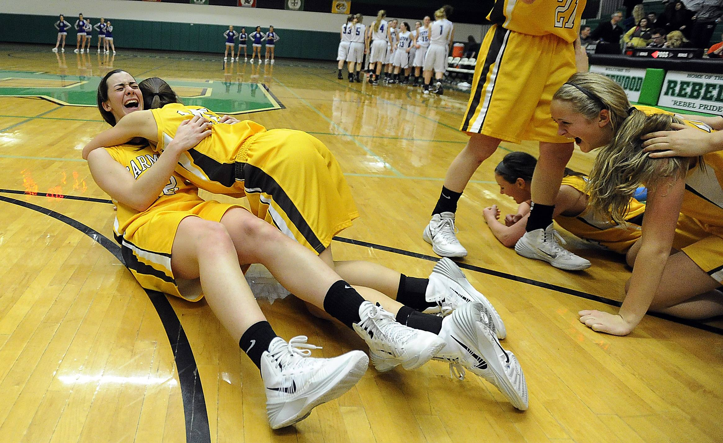 Carmel's Kathleen Fellcelli and Paige Gauthier (15) celebrate their victory over Vernon Hills.