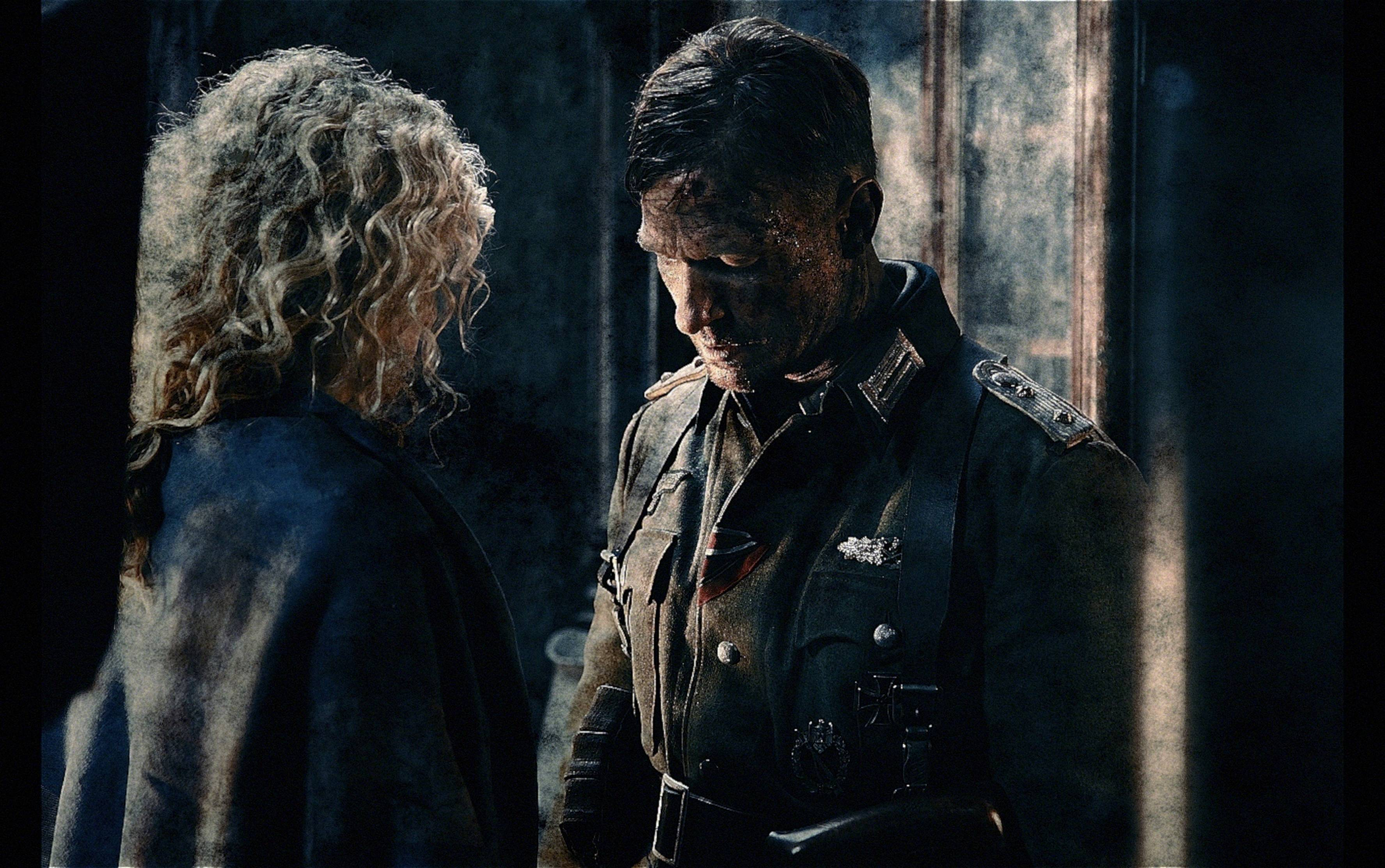 "A German officer (Thomas Kretschmann), right, falls for a Russian beauty (Yanina Studilina) in the Russian film ""Stalingrad."""