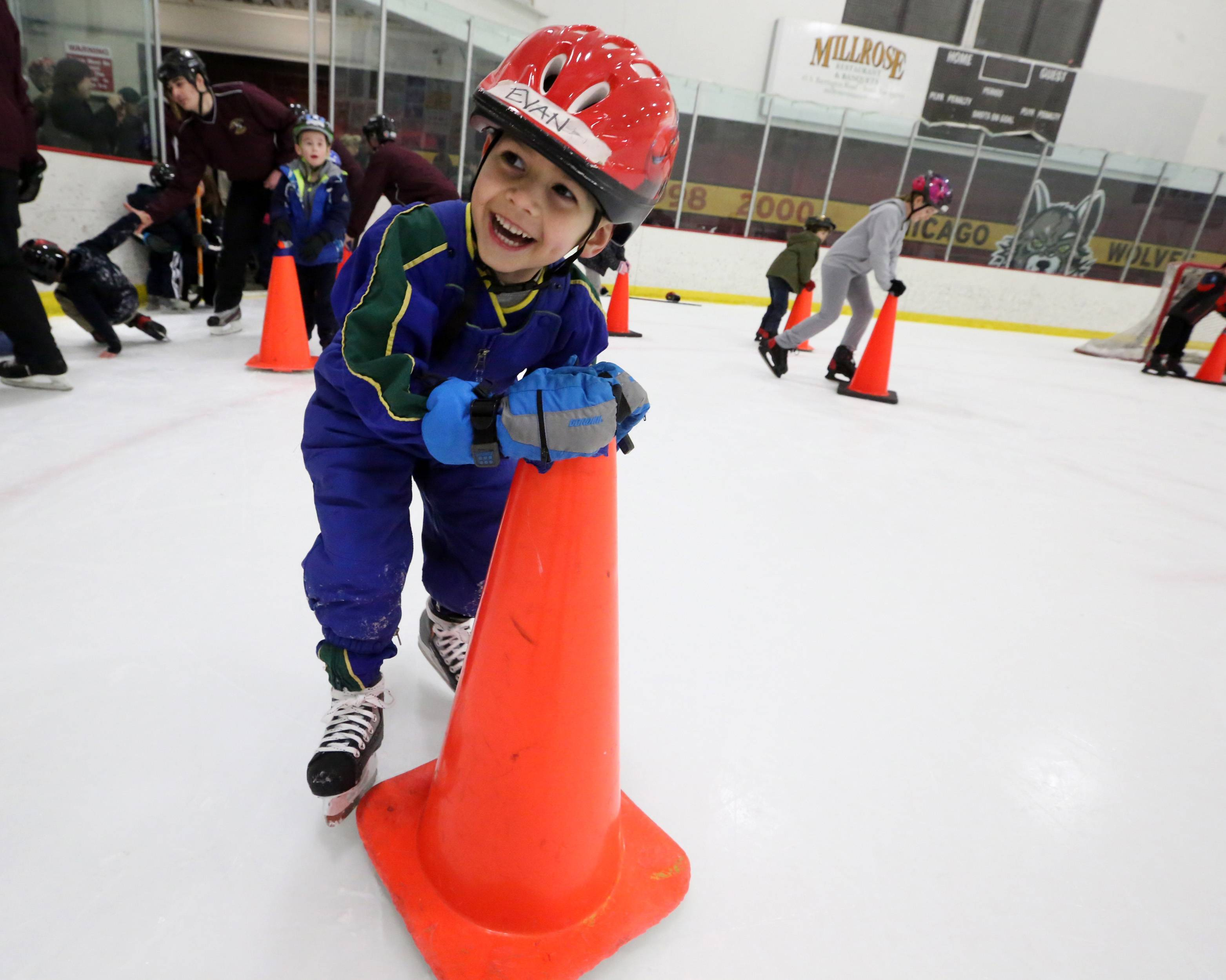 George LeClaire/gleclaire@dailyherald.comEvan Sher, 5, of Hanover Park, learns to stay up on his skates using an orange traffic cone at USA Hockey's annual Try Hockey For Free event at the Triphahn Center on Saturday in Hoffman Estates.