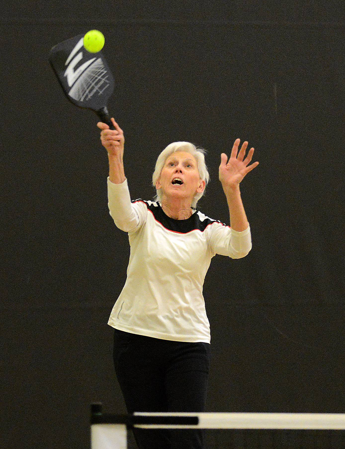 Rick West/rwest@dailyherald.comChris Bolliger, of St. Charles, hits an overhead smash while playing pickleball at Pottawatomie Community Center in St. Charles Thursday. She said she picked up the game about 6 months ago.
