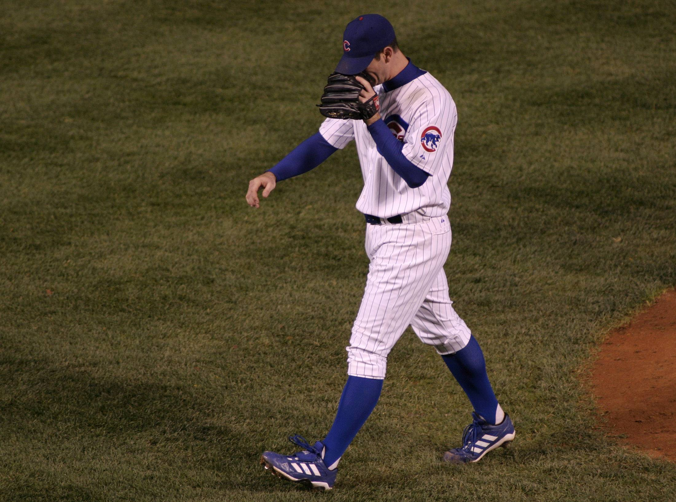 After perhaps the most bizarre and heartbreaking inning in Cubs' history, pitcher Mark Prior talks to himself as he walks off the mound, about to be the losing pitcher of pivotal Game 6 of the National League championship series in 2003.