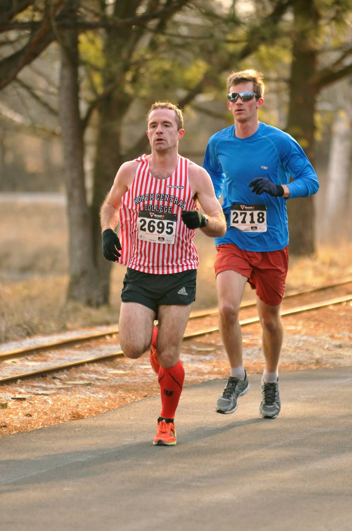Alex Taylor (bib 2718) was the top finisher in the 2013 5K Spring Gallop, edging Nathan Kennedy (2695) by two seconds to win the overall title.