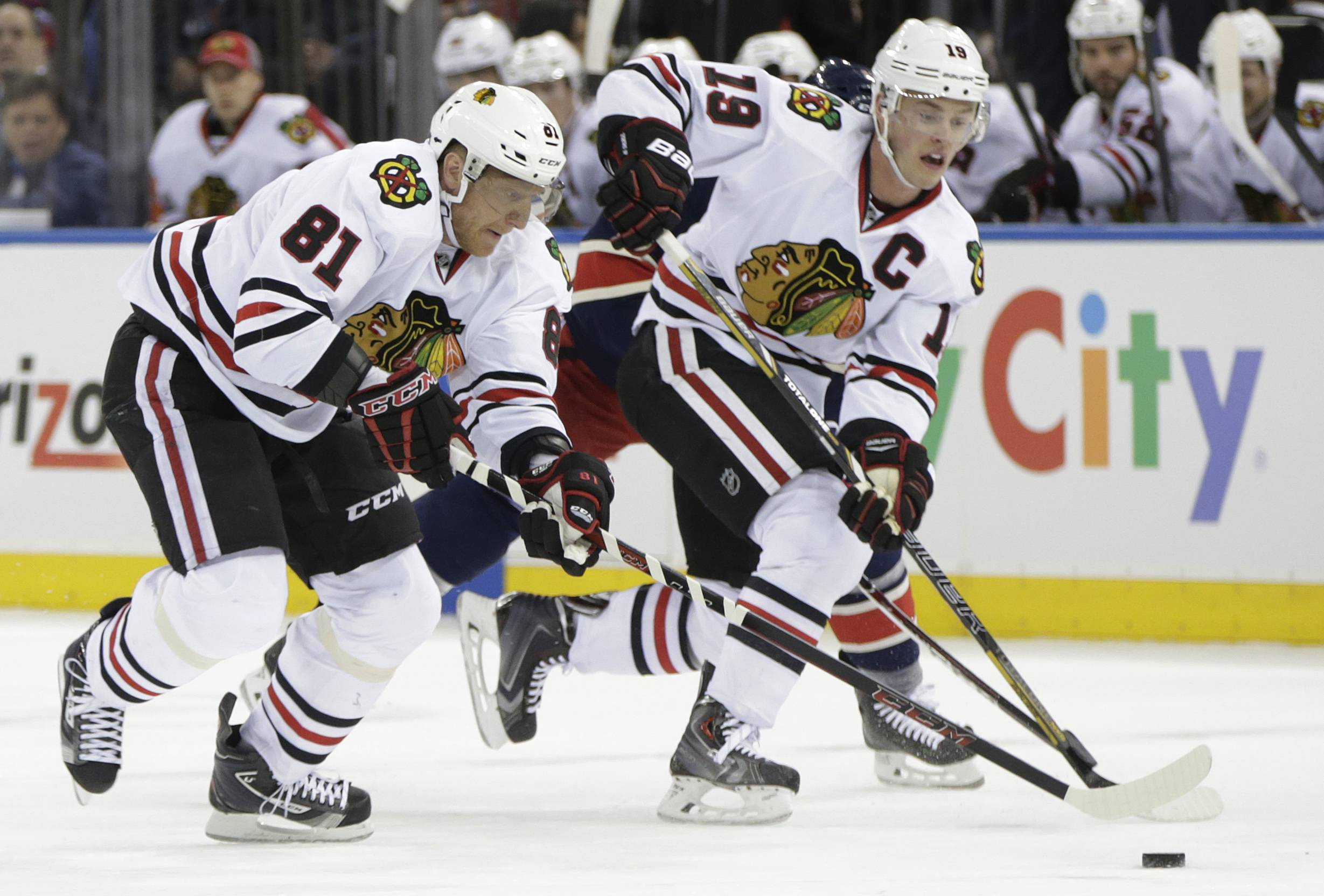 The Blackhawks' Marian Hossa (81) and Jonathan Toews move the puck up the ice during the first period Thursday against the Rangers at Madison Square Garden in New York.