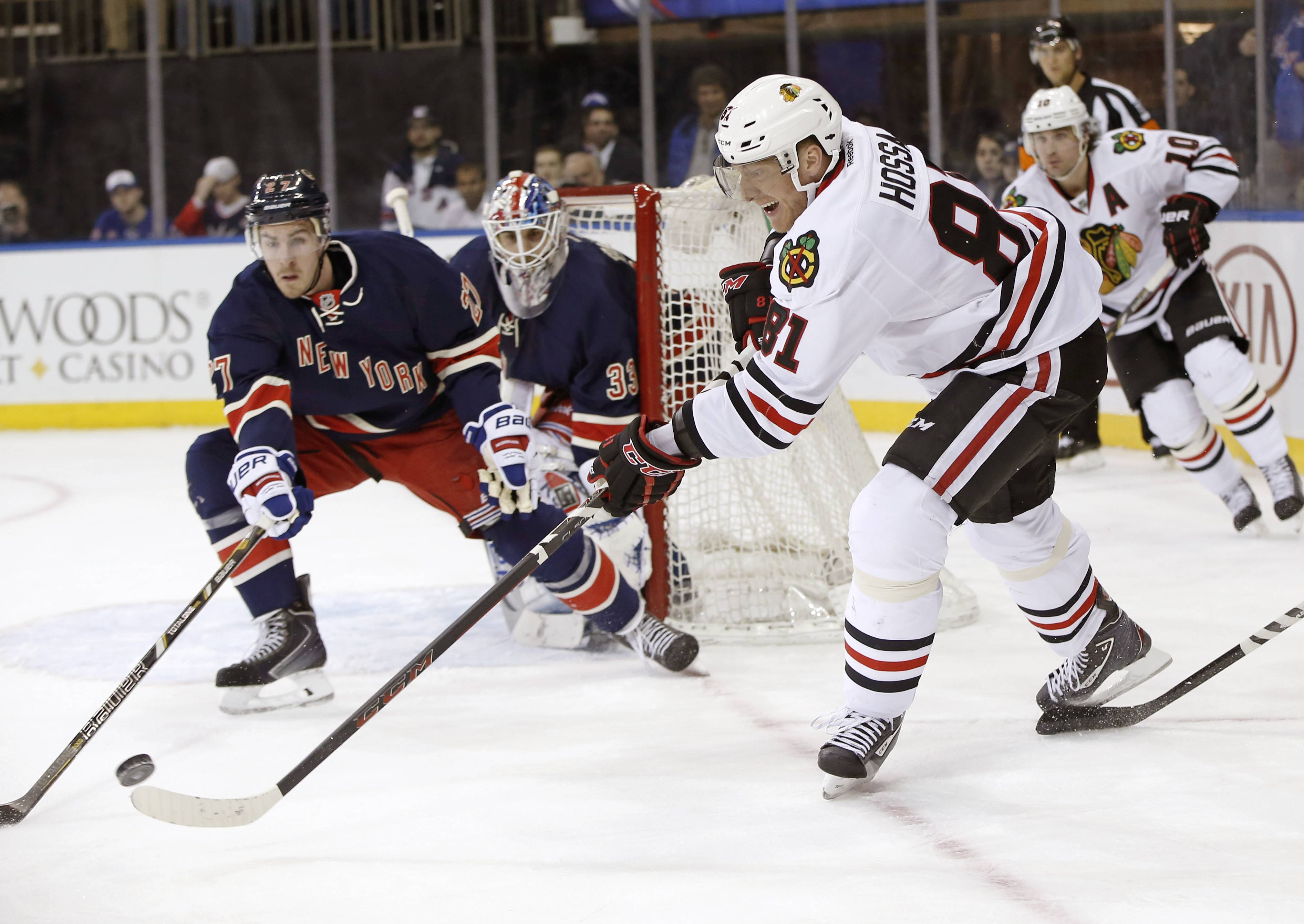 Rangers defenseman Ryan McDonagh defends against the Blackhawks' Marian Hossa in the third period Thursday at Madison Square Garden in New York.
