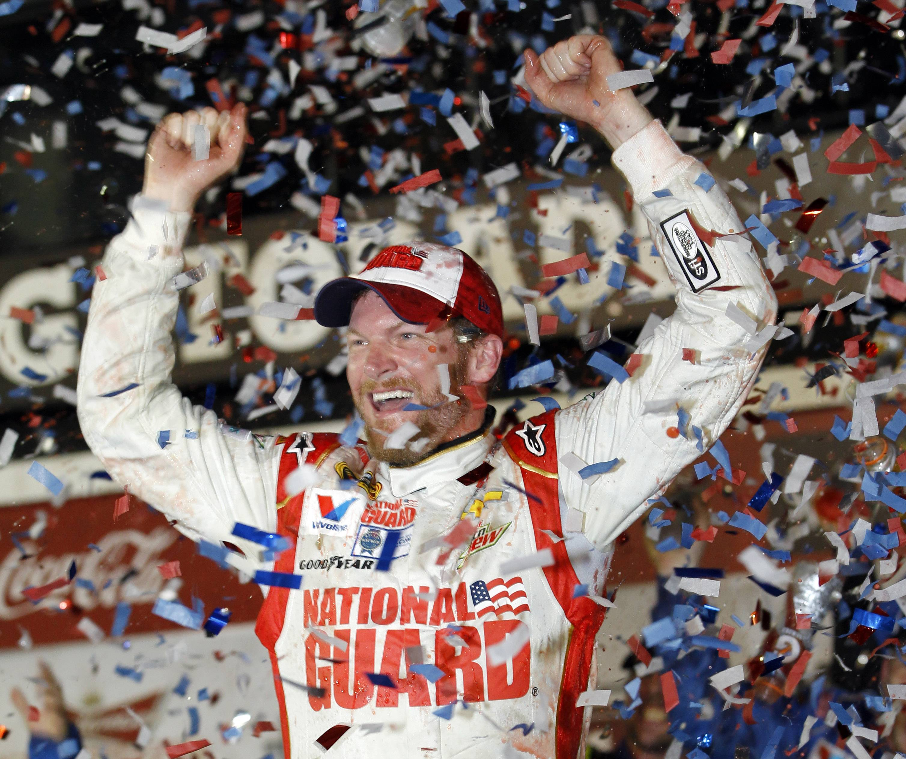 Dale Earnhardt Jr. celebrates in Victory Lane after winning the NASCAR Sprint Cup Series Daytona 500 on Sunday at Daytona International Speedway in Florida.