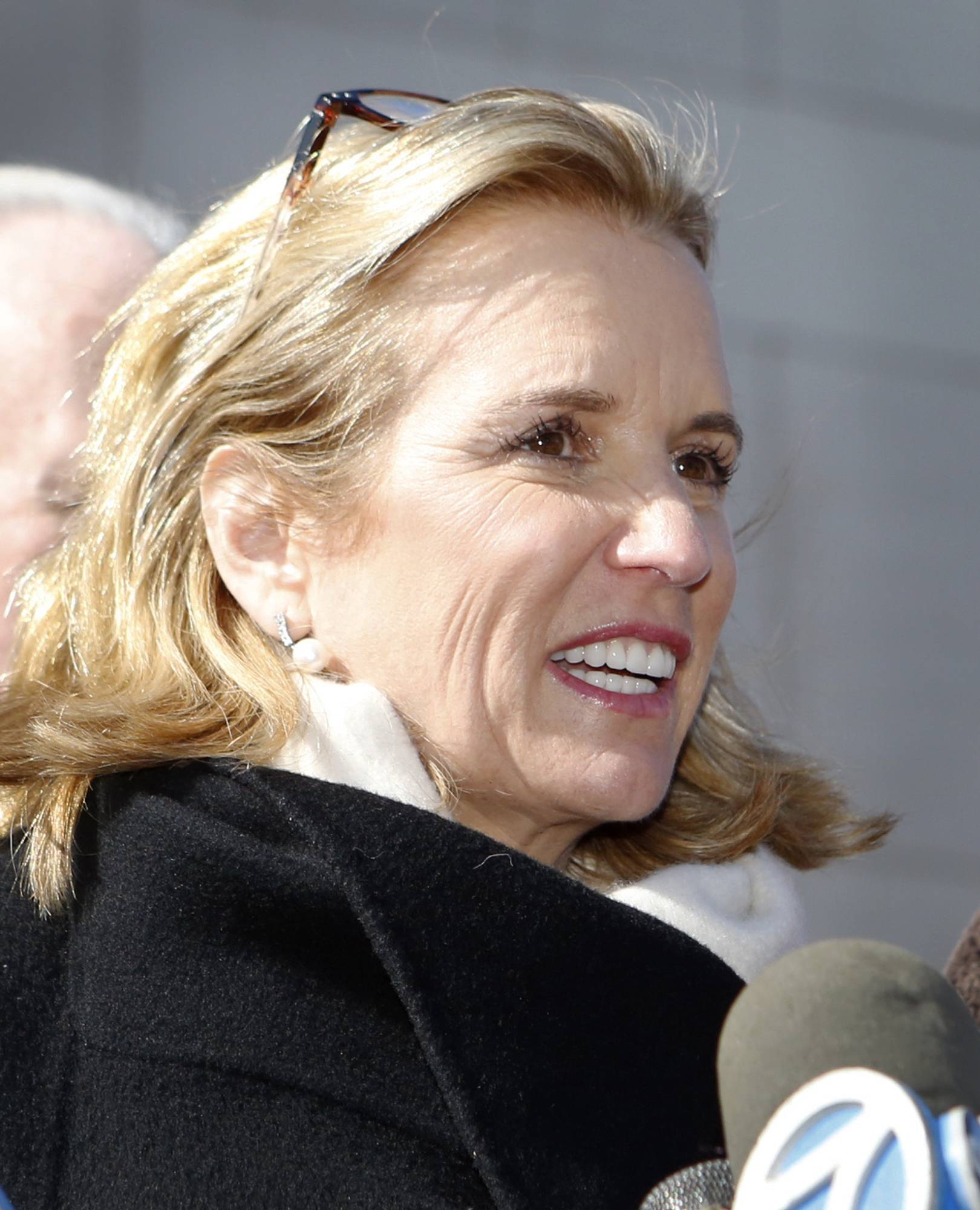 Kerry Kennedy talks to reporters Friday after leaving the Westchester County Courthouse.