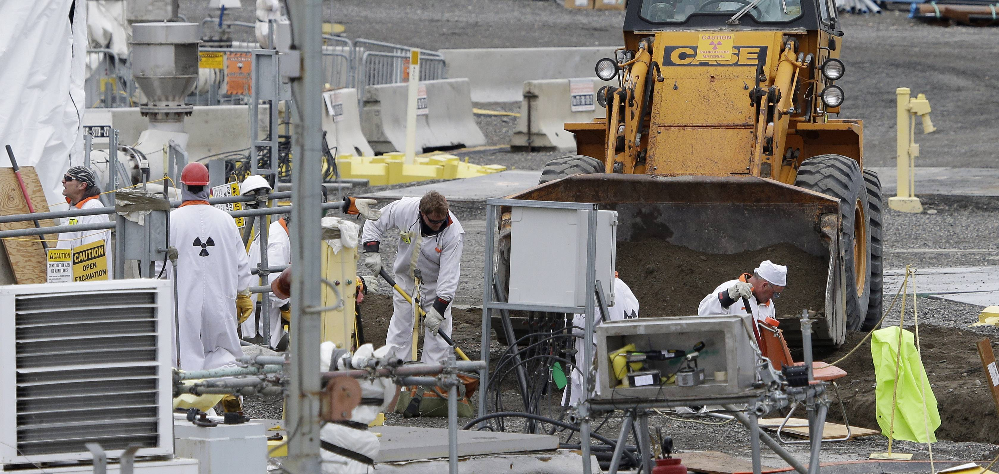 "Workers labor at the 'C' Tank Farm at the Hanford Nuclear Reservation, near Richland, Wash. Documents obtained by the Associated Press show that there are ""significant construction flaws"" in some newer, double-walled storage tanks at the nuclear waste complex."