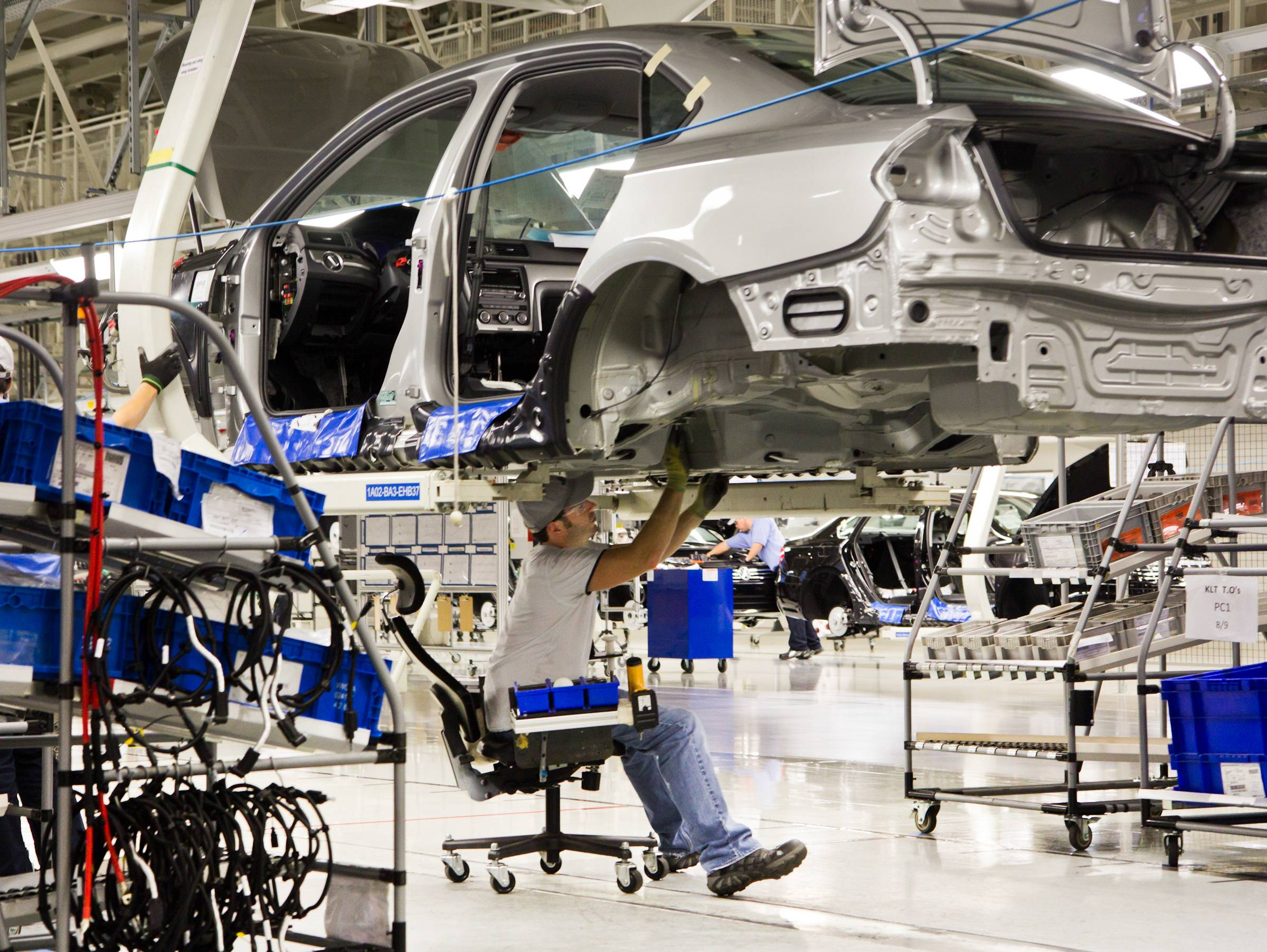 An employee works on a Passat sedan at the Volkswagen plant in Chattanooga, Tenn.