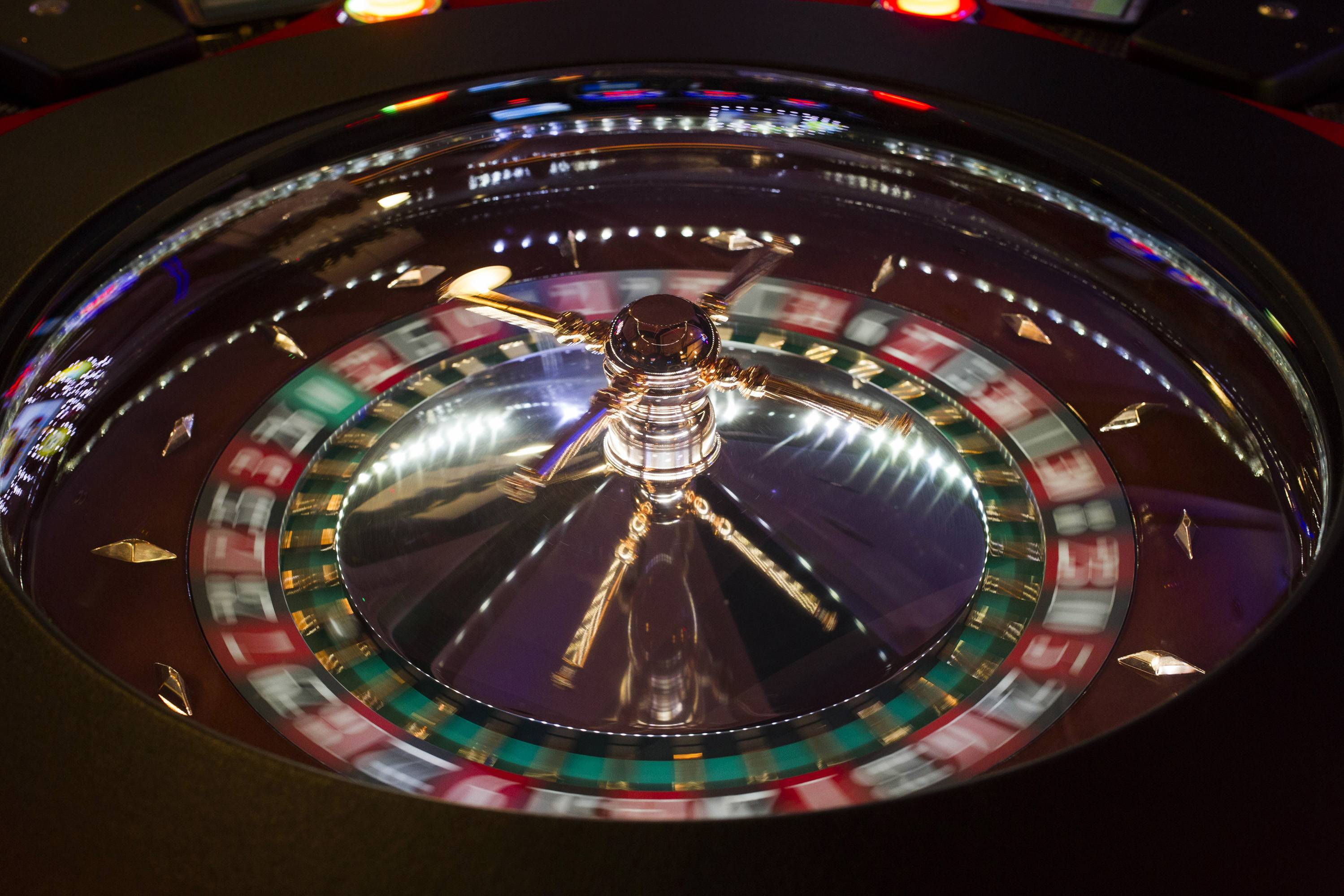 A ball rolls around a spinning roulette wheel.