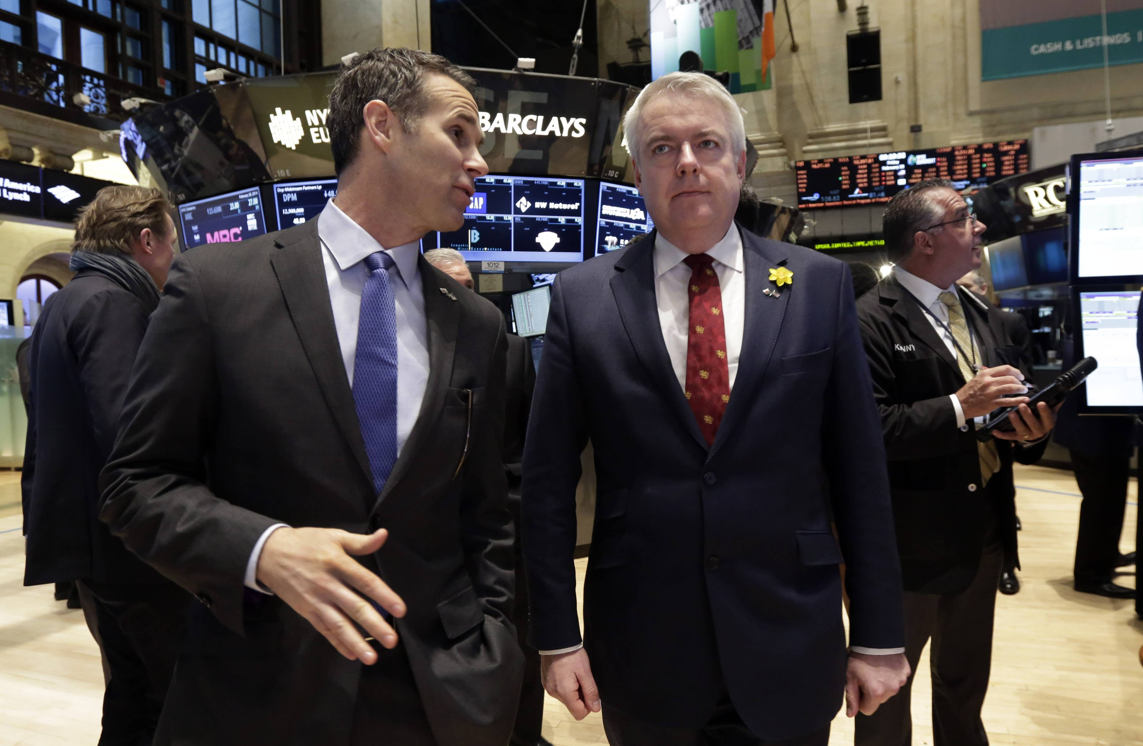 First Minister of the Welsh Government Carwyn Jones, right, visits the trading floor of the New York Stock Exchange Friday with NYSE Vice President Scott Cutler before ringing the opening bell.