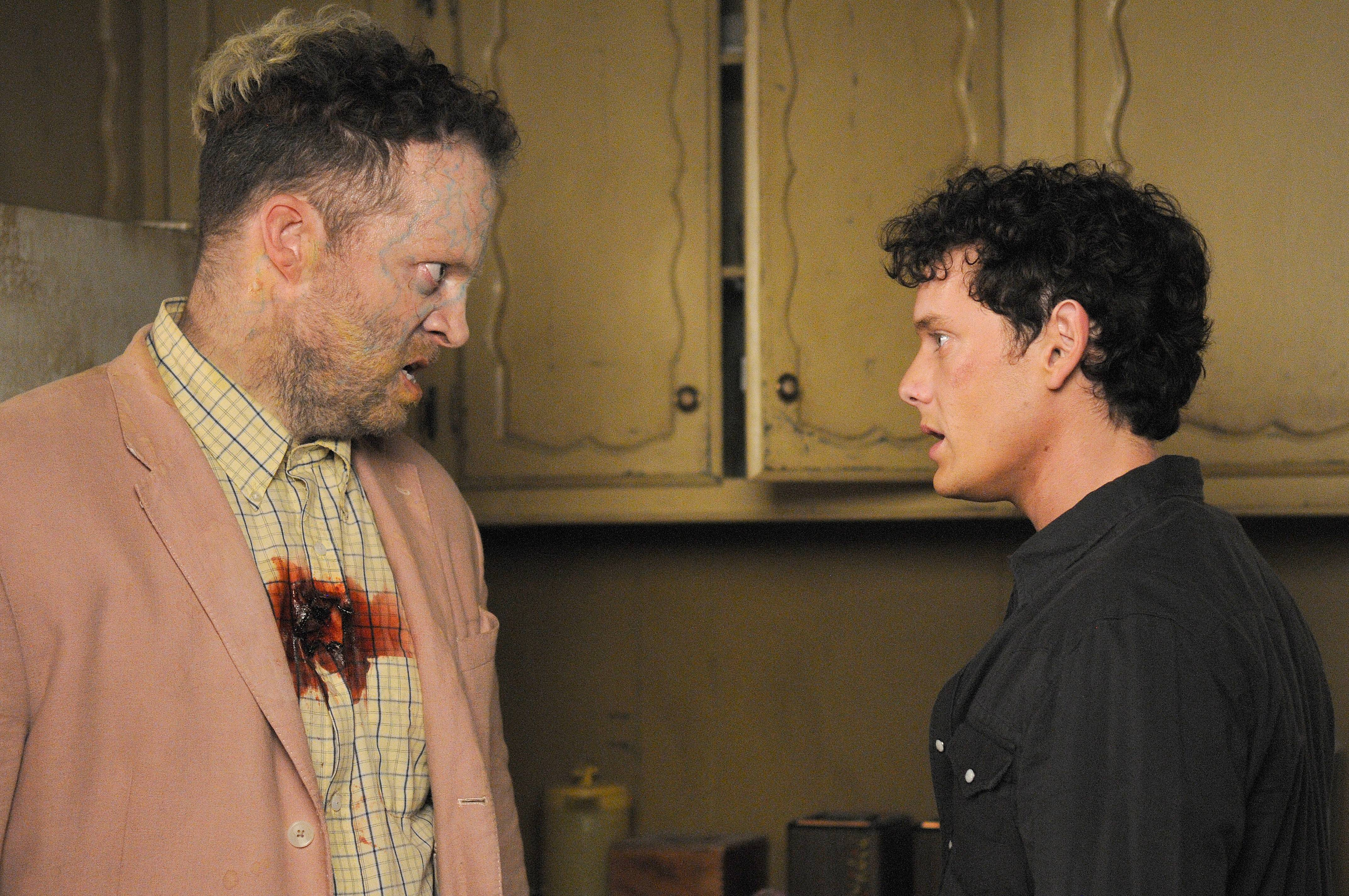 "Odd Thomas (Anton Yelchin), right, confronts a very irate dead person in Stephen Sommers' ""Odd Thomas,"" based on a Dean Koontz novel."