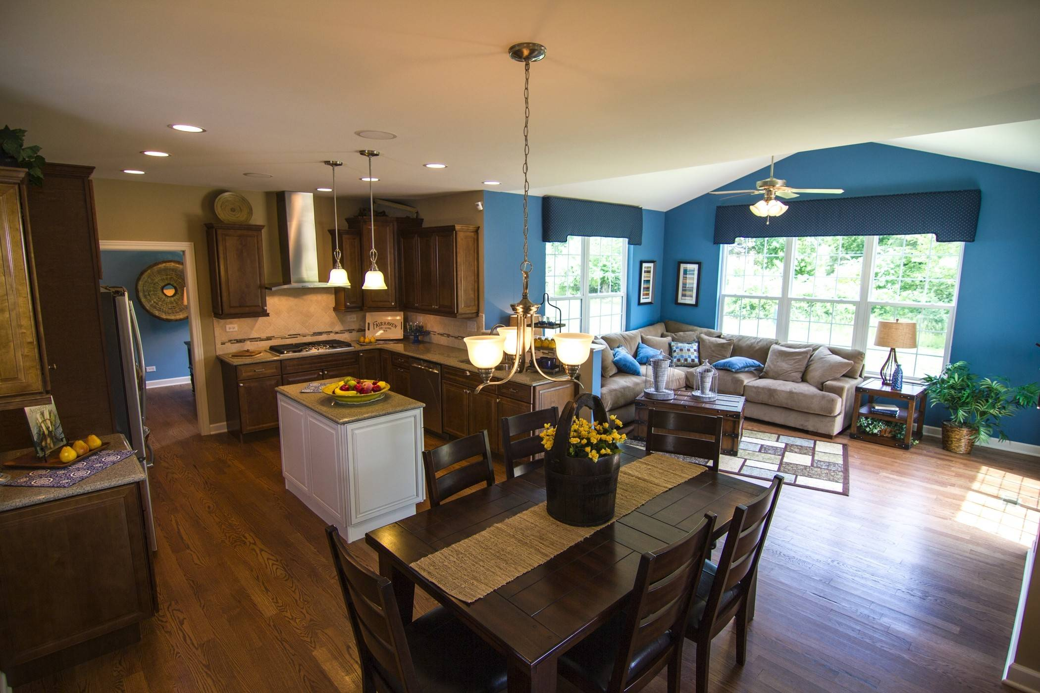 The Jasper model features an open floor plan with a four-season morning room just off the kitchen. This model home is at Walnut Glen in Island Lake.