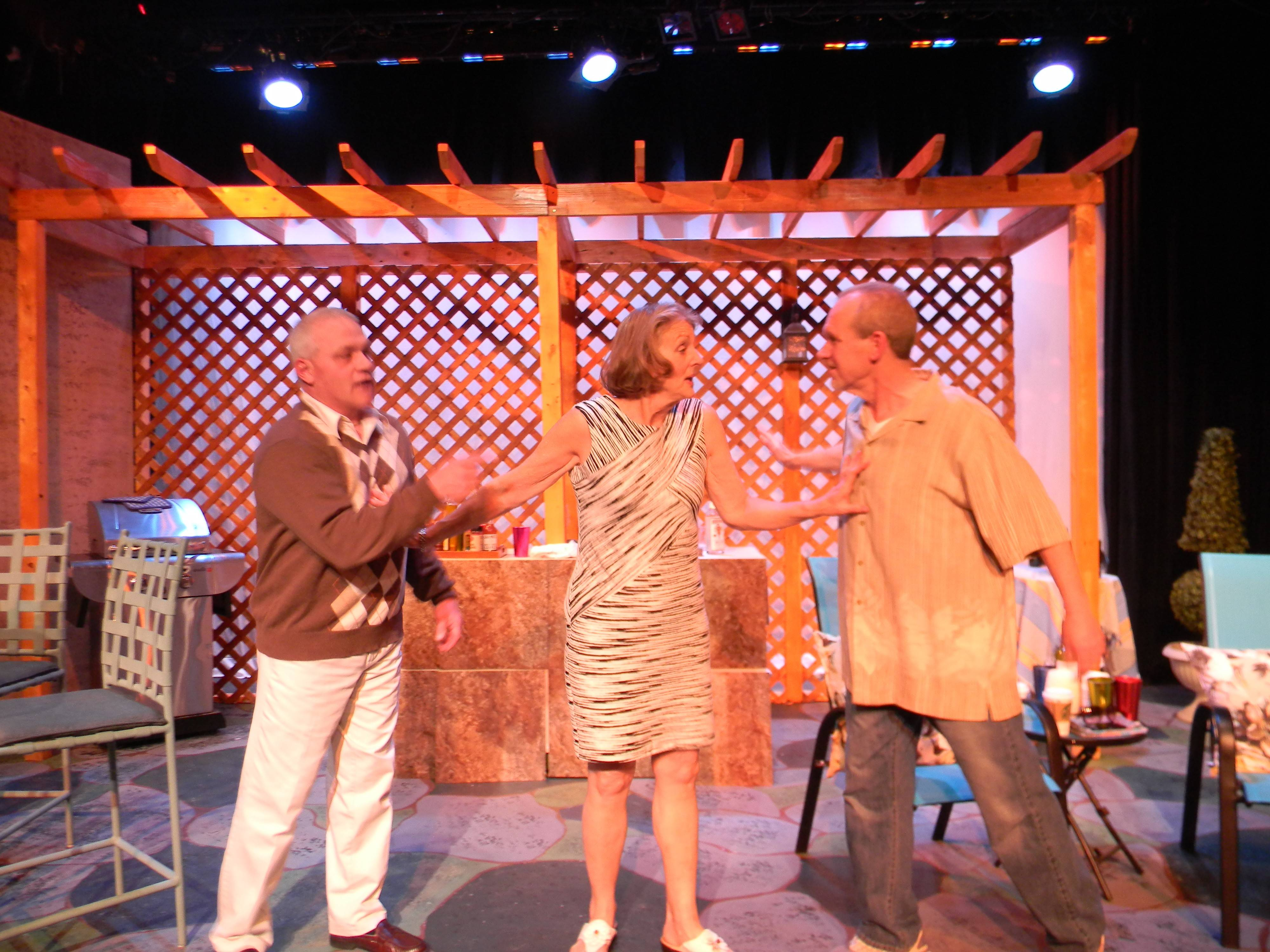 "The arrival of her ex-husband Jack (Pat Able, right) ignites sparks between Gwen (Donna Steele) and her current husband Norm (Bill Sherry, left) in Richard Culliton's dramedy ""The Bay of Portugal,"" in its world premiere at Steel Beam Theatre."