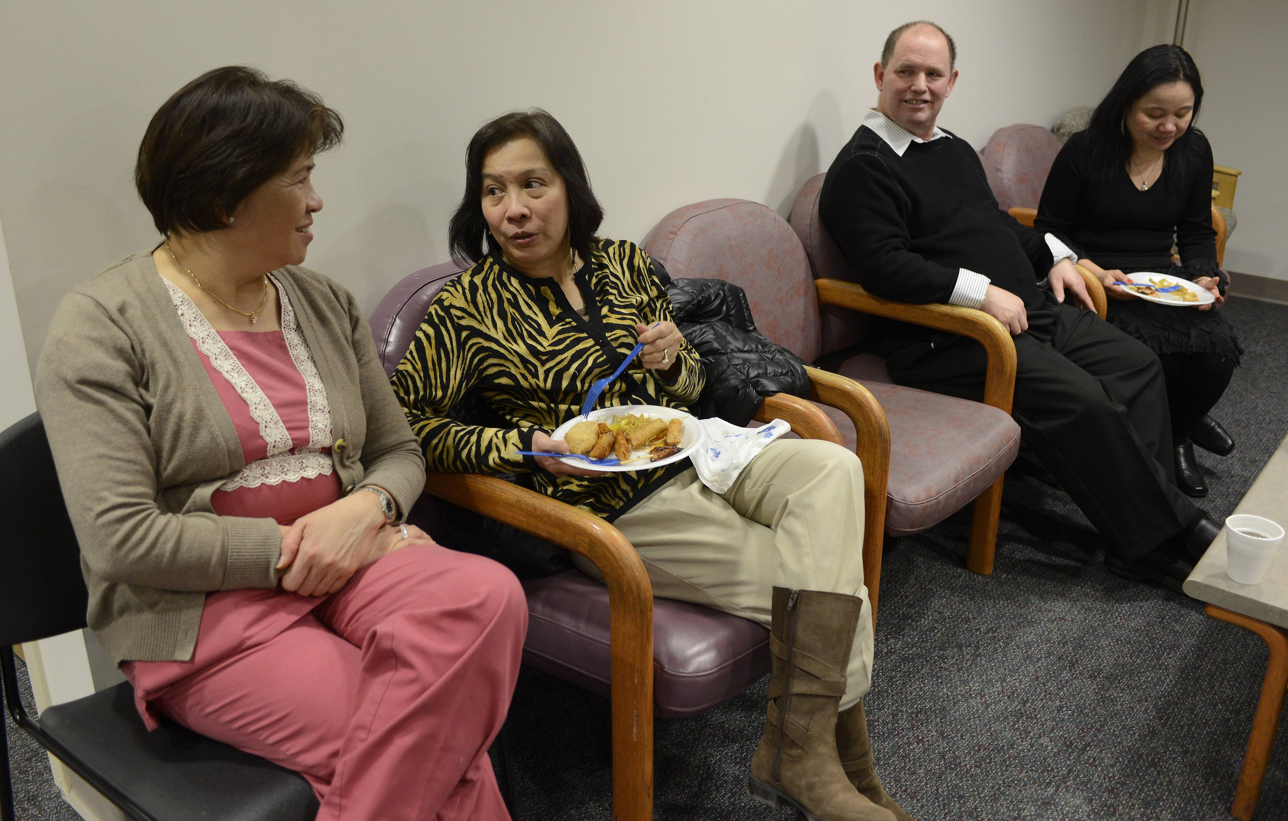 Ofelia Dionsio, left, aunt of Allen Belaguas, chats with nurse Terri Gagula during the Friday luncheon hosted by Allen's parents George and Zita Pierson, in the background.