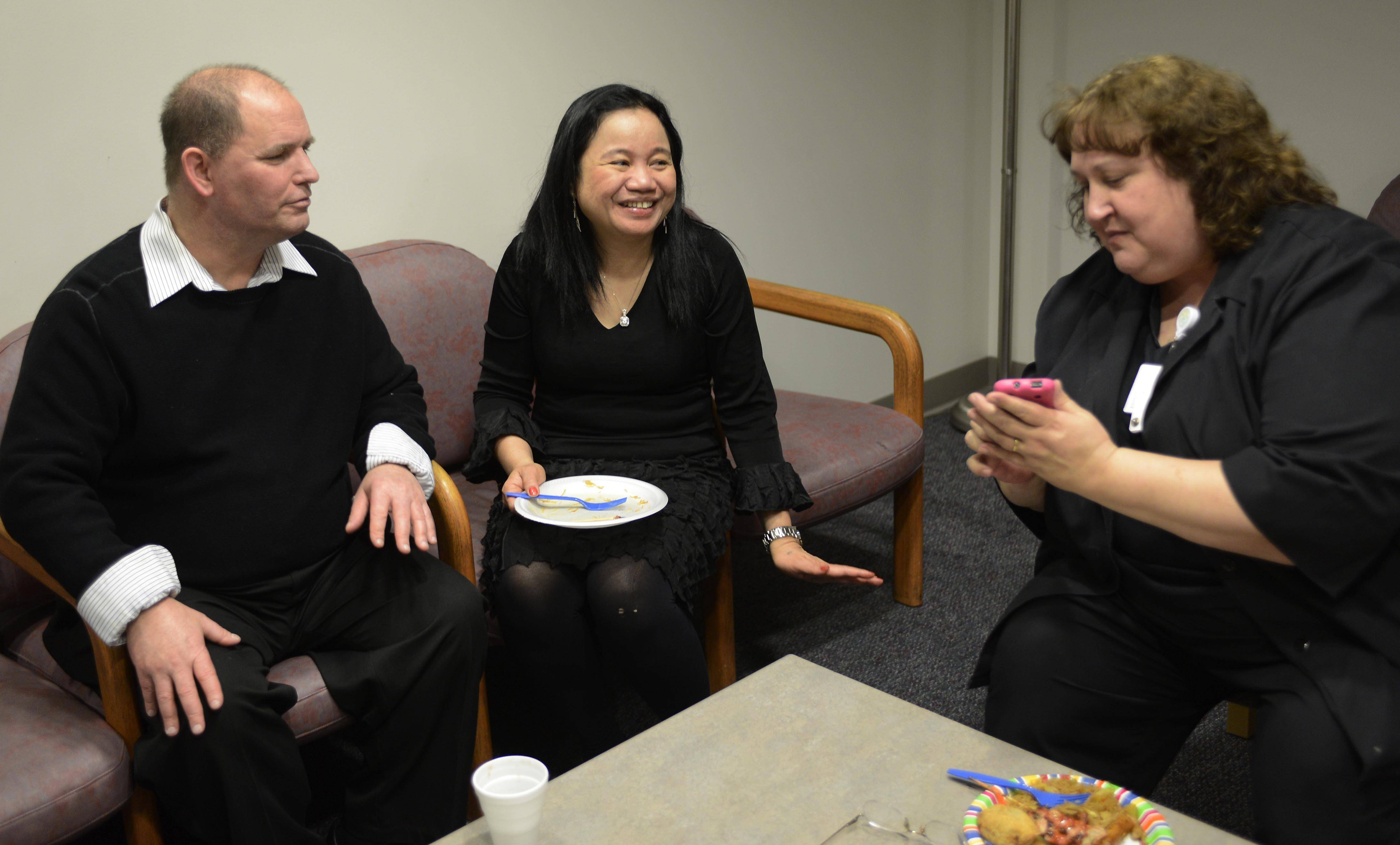 George and Zita Pierson, parents of Naperville fire victim Allen Belaguas, chat with nurse case manager Kristin McCarthy.