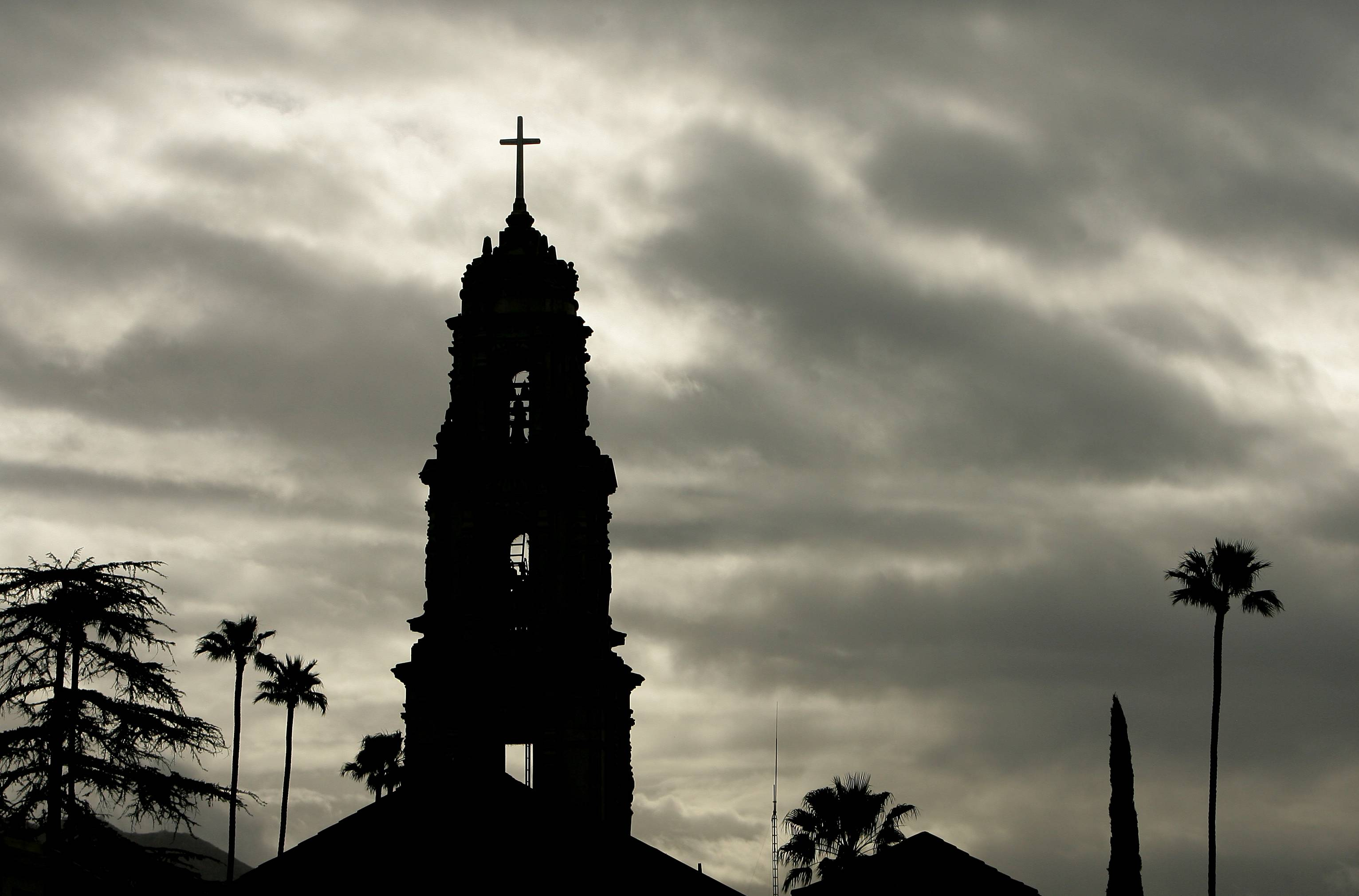 The bell tower at First Congregational Church in downtown Riverside, Calif. is silhouetted Saturday against cloudy skies.
