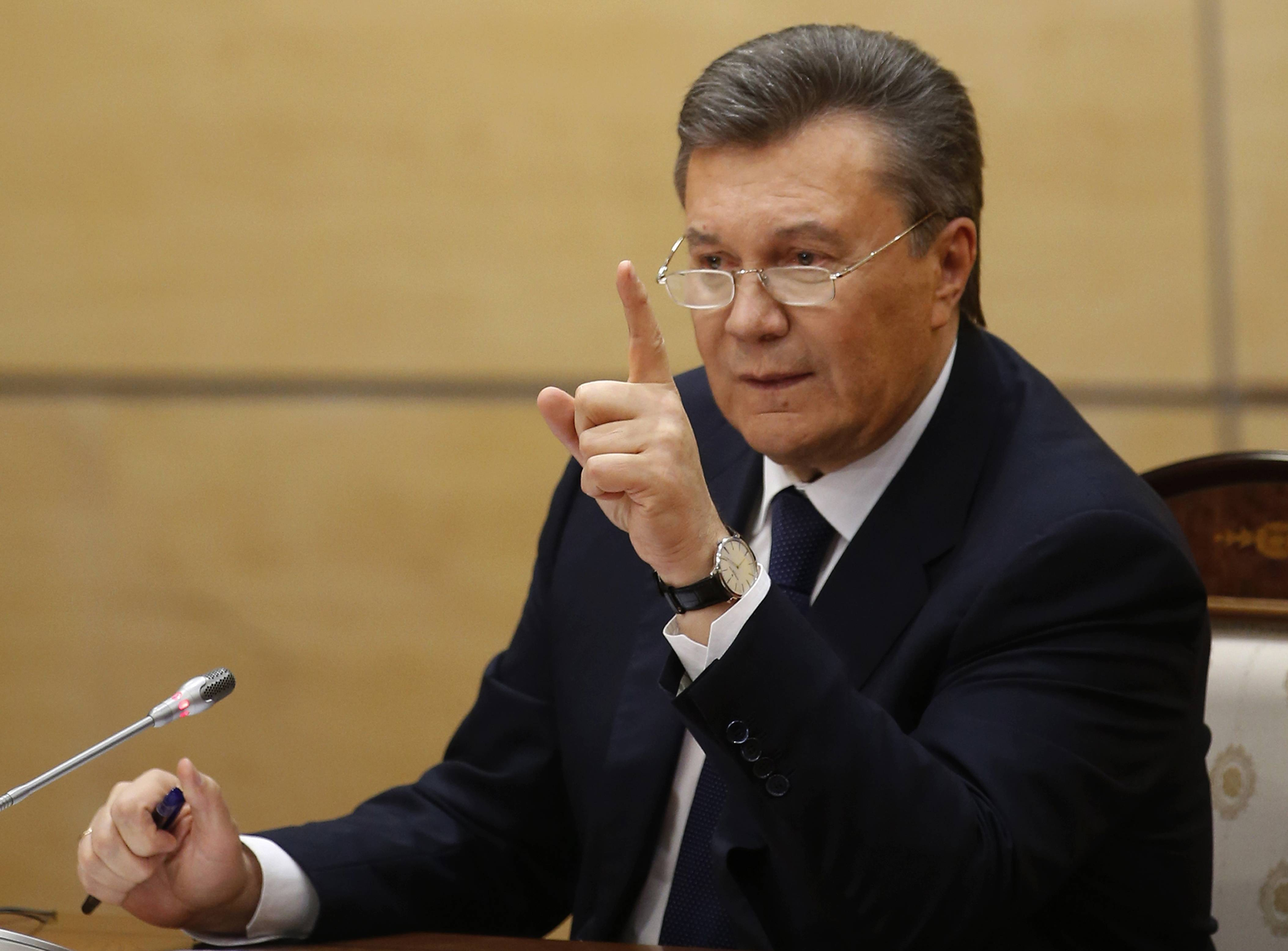 Ukraine's fugitive President Viktor Yanukovych gives a news conference Friday in Rostov-on-Don, a city in southern Russia about 600 miles from Moscow. Making his first public appearance since fleeing Ukraine, Yanukovych pledged Friday to fight for his country's future but said he will not ask for military assistance.