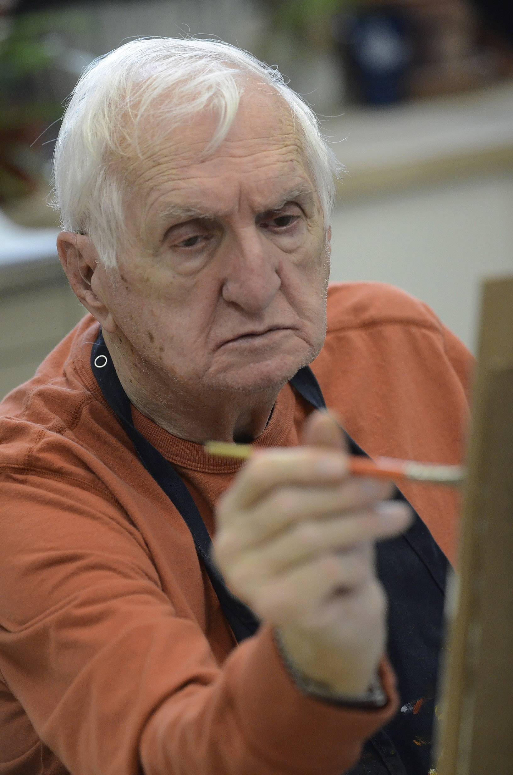 83-year-old painting student Chuck McCann of Round Lake Beach, who suffers from Parkinson's disease, works during art class at College of Lake County.