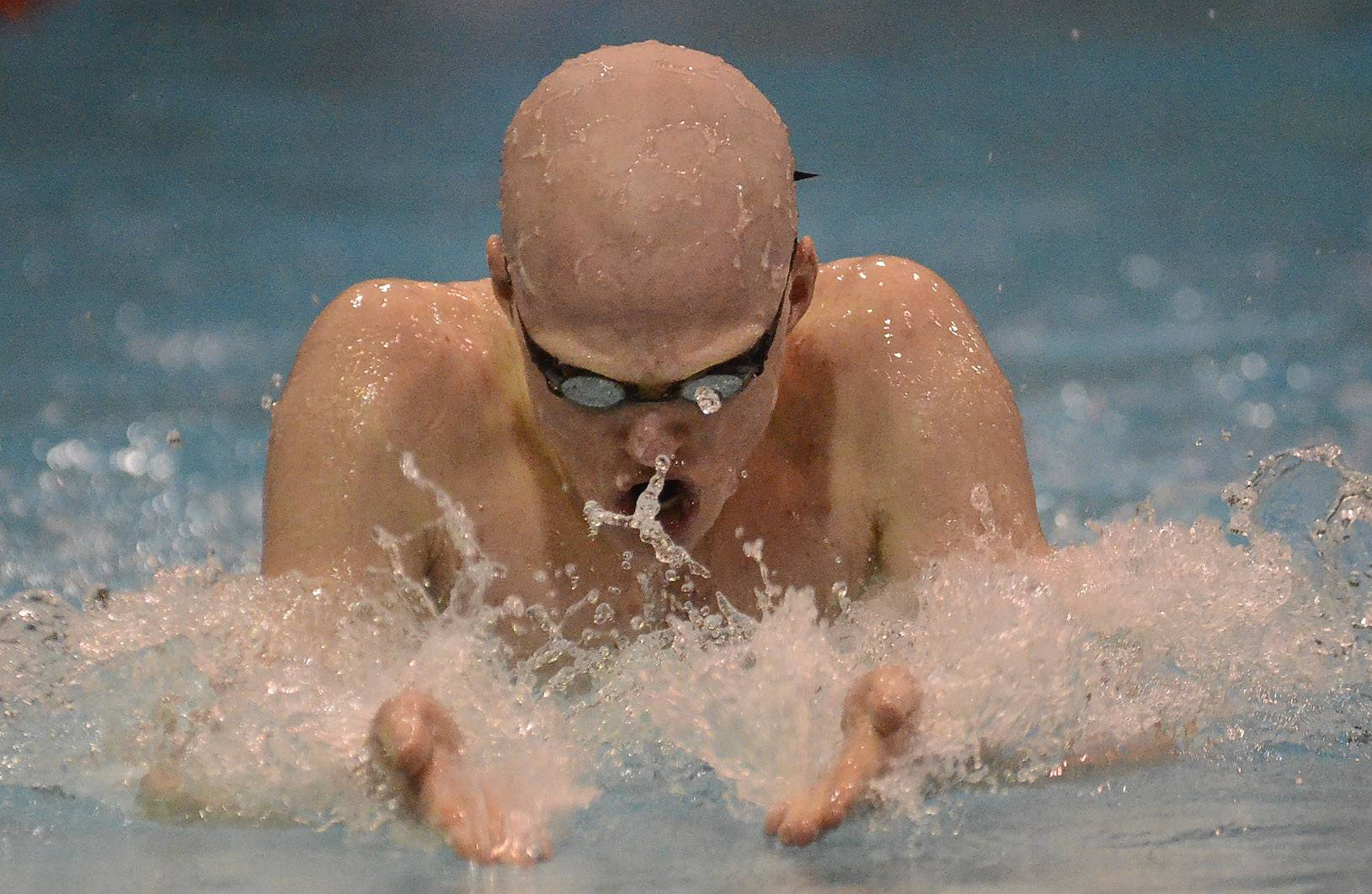 Jake Barson of Rolling Meadows qualifies ninth in the 100 breaststroke during the boys swimming state meet prelims Friday at Evanston Township High School.