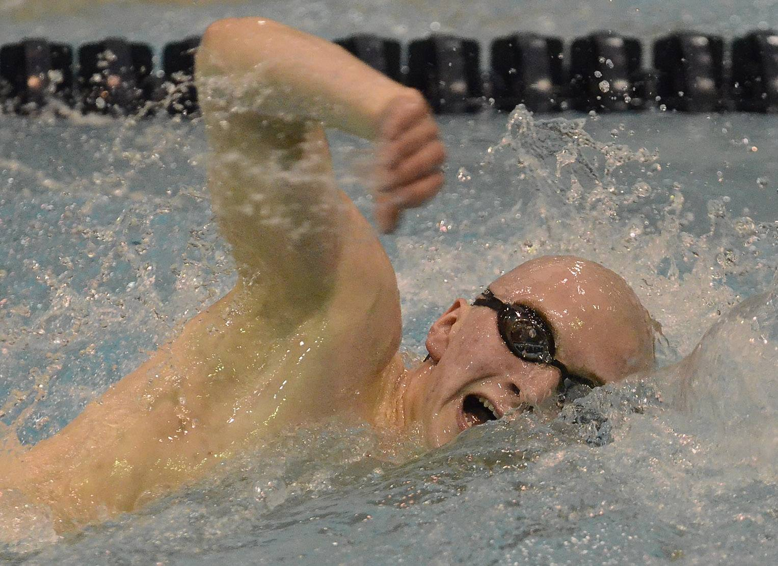 Michael Connor of Maine West competes in the 200 freestyle during the boys swimming state meet prelims Friday at Evanston Township High School.