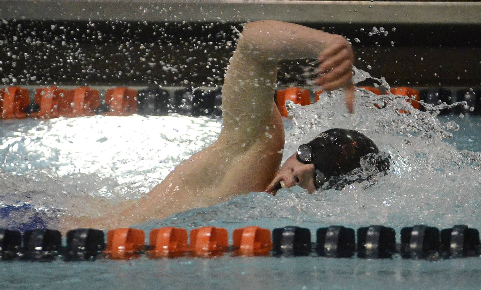 Colin Williams of Elk Grove Village competes in the 200 freestyle during the boys swimming state meet prelims Friday at Evanston Township High School.