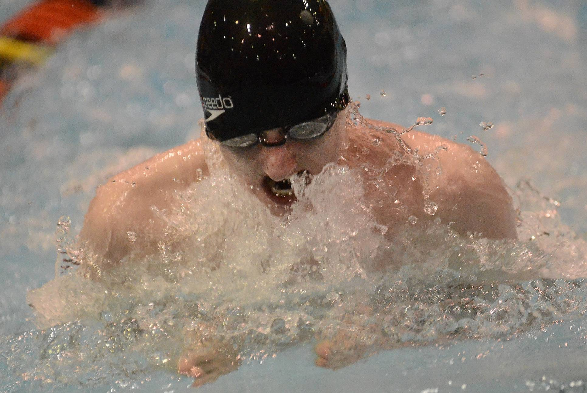 Colin Cross of Barrington swims the second leg of the 200 medley relay during the boys swimming state meet prelims Friday at Evanston Township High School.