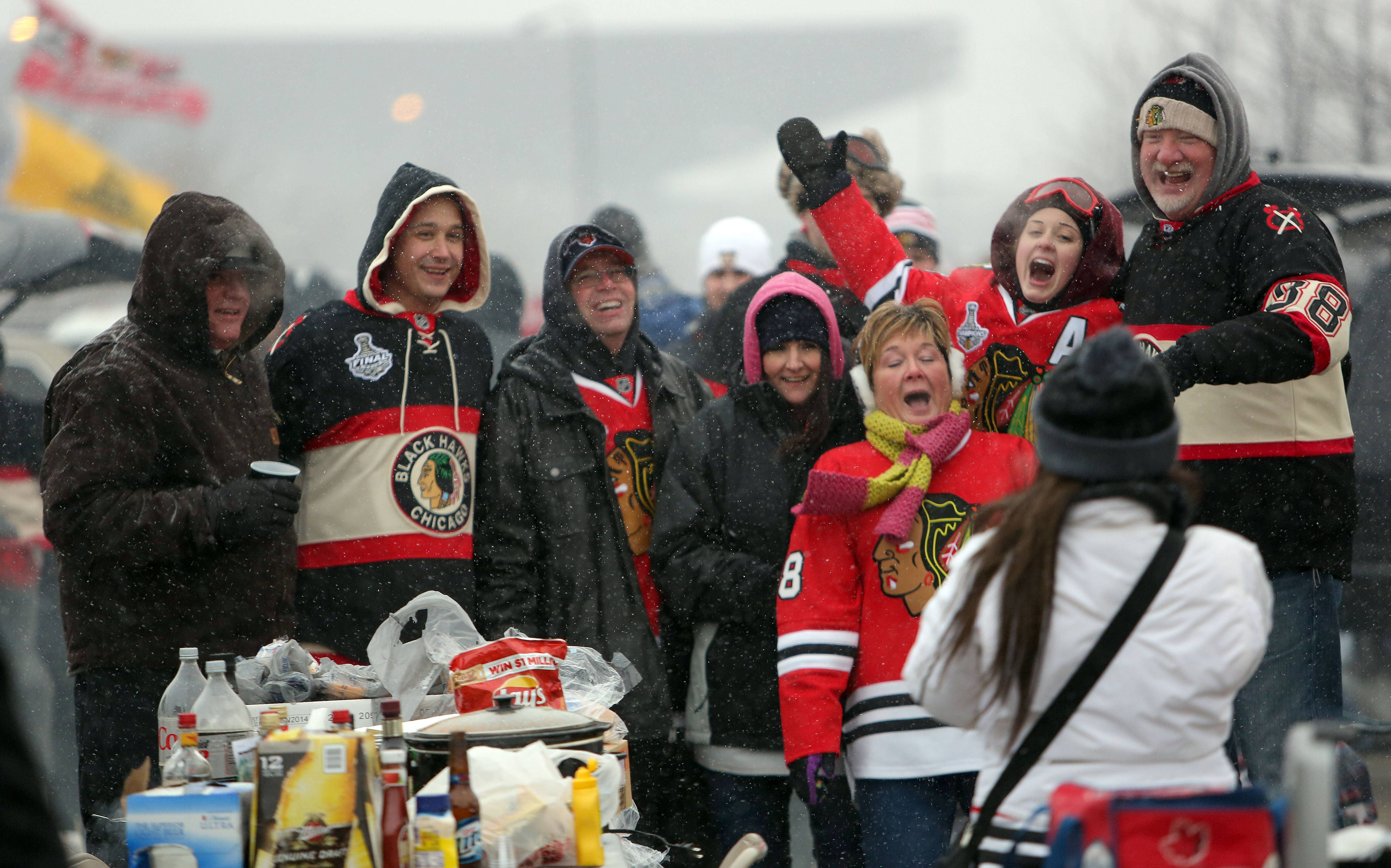Steve Lundy/slundy@dailyherald.comHawks tailgaters pose for a picture prior to the Blackhawks vs Penguins NHL Stadium Series Saturday at Soldier Field.