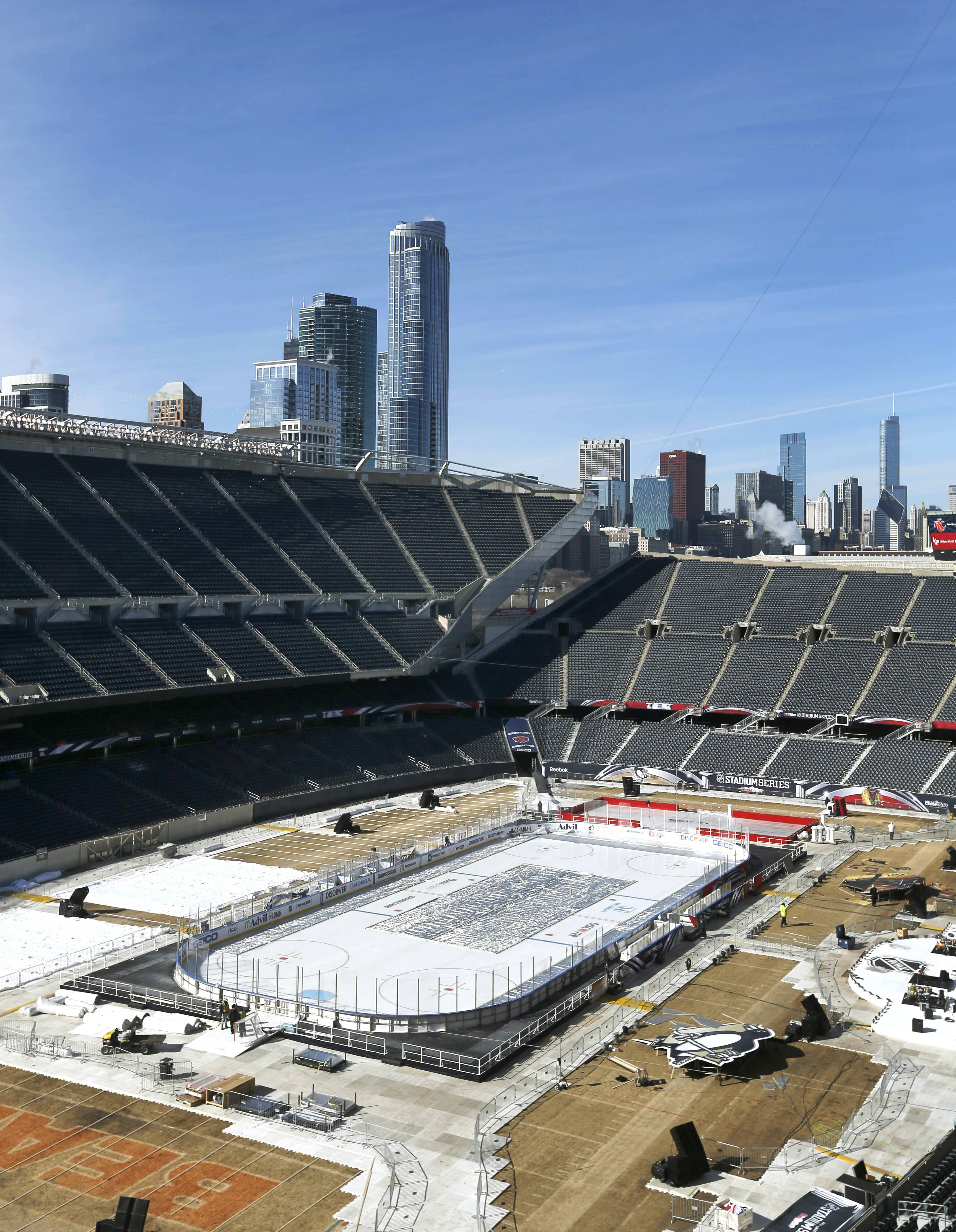 With the downtown skyscrapers as a backdrop, Soldier Field has been transformed into anoutdoor ice palace for today's Stadium Series game between the Hawks and Penguins.