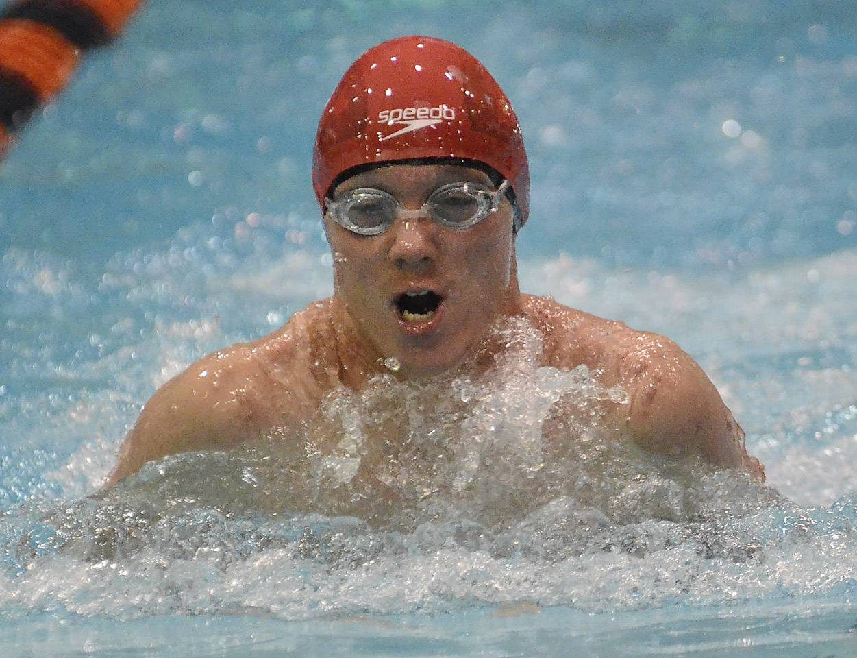 Phillip Sajaev of Naperville Central swims the 200 medley relay .