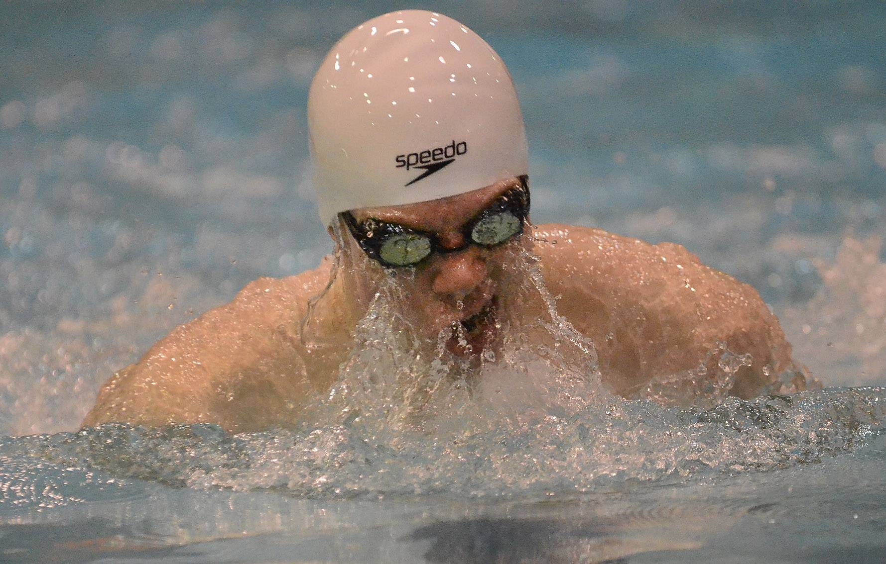 Adam Eibel of Cary-Grove competes in the 100 breaststroke .