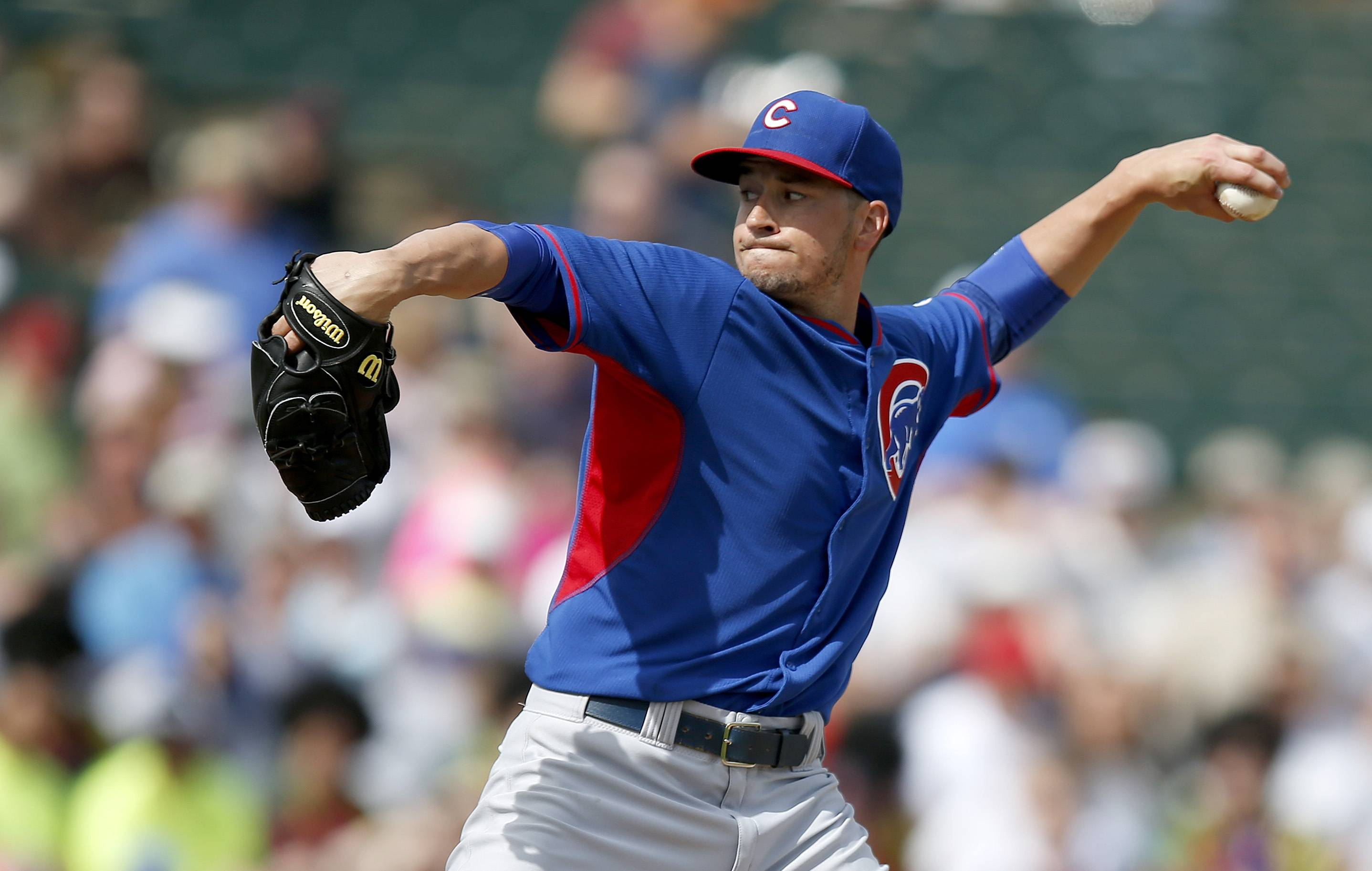Chicago Cubs' Chris Rusin throws a pitch in the first inning during a spring training baseball game against the Los Angeles Angels, Friday, Feb. 28, 2014, in Tempe, Ariz. The Angels won 15-3.