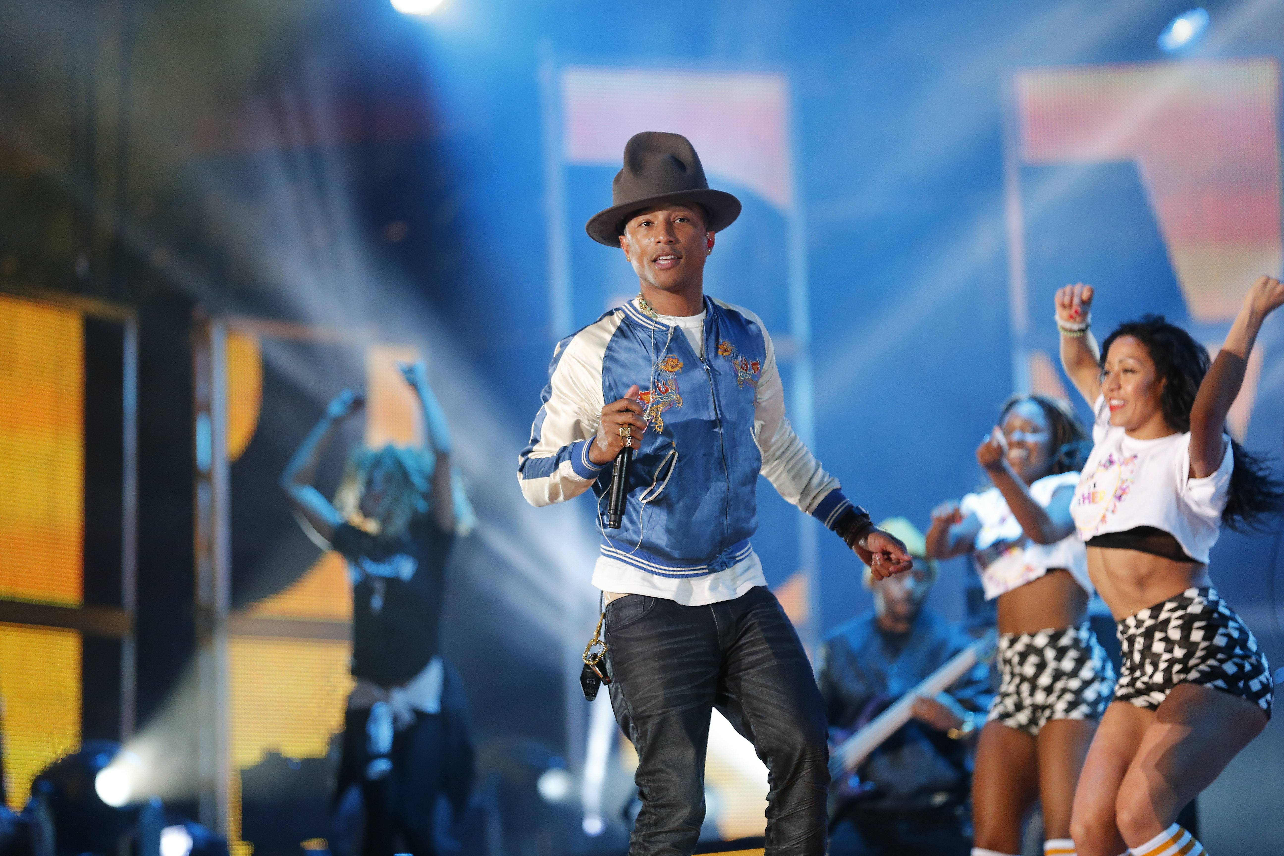 "Pharrell Williams rehearses before the NBA All-Star basketball game in New Orleans. The producer-rapper-singer's tune ""Happy"" is nominated for best original song at the Oscars, to be announced Sunday, March 2."