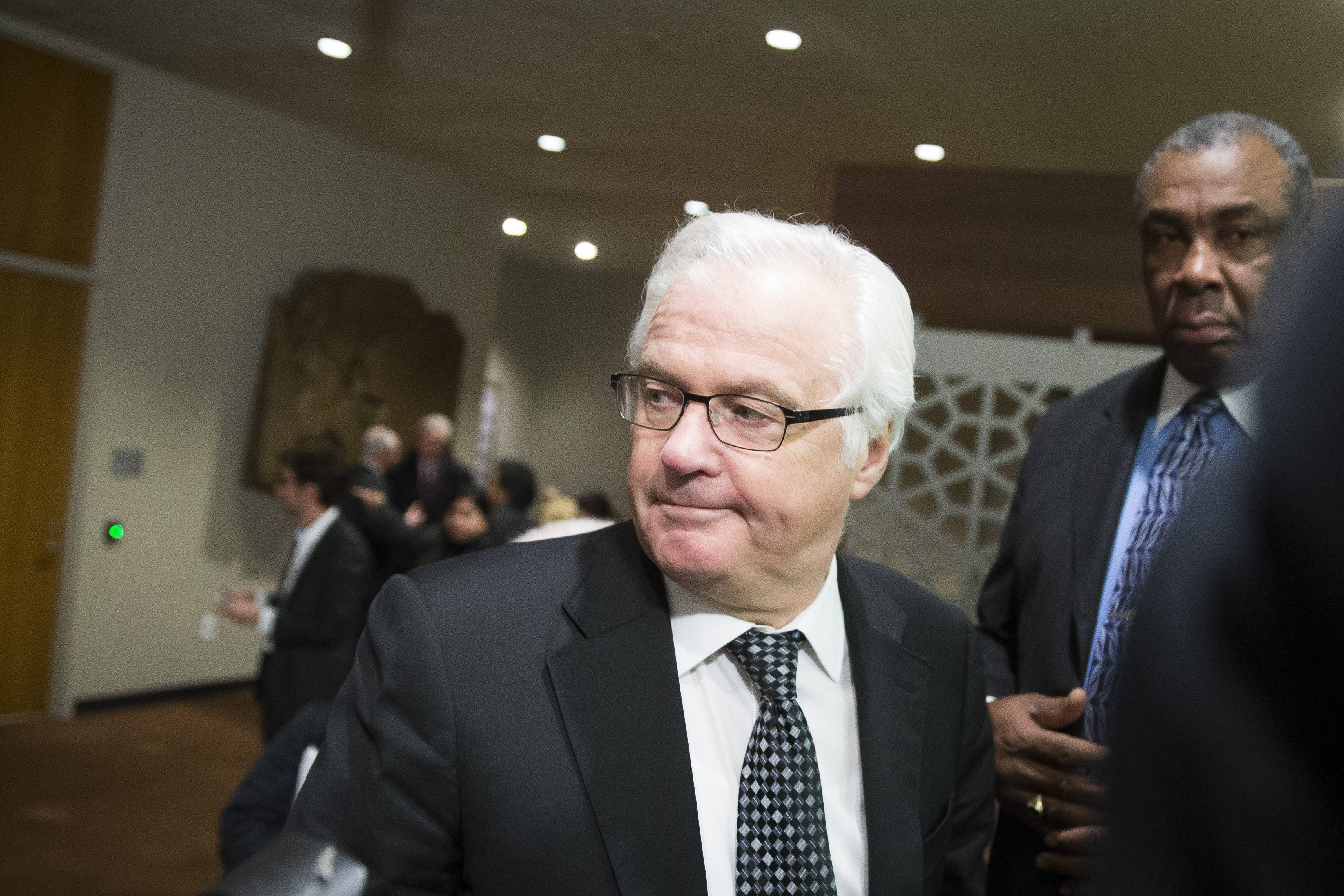 Russia's U.N. Ambassador Vitaly Churkin heads toward the exit Saturday following an U.N. Security Council meeting.
