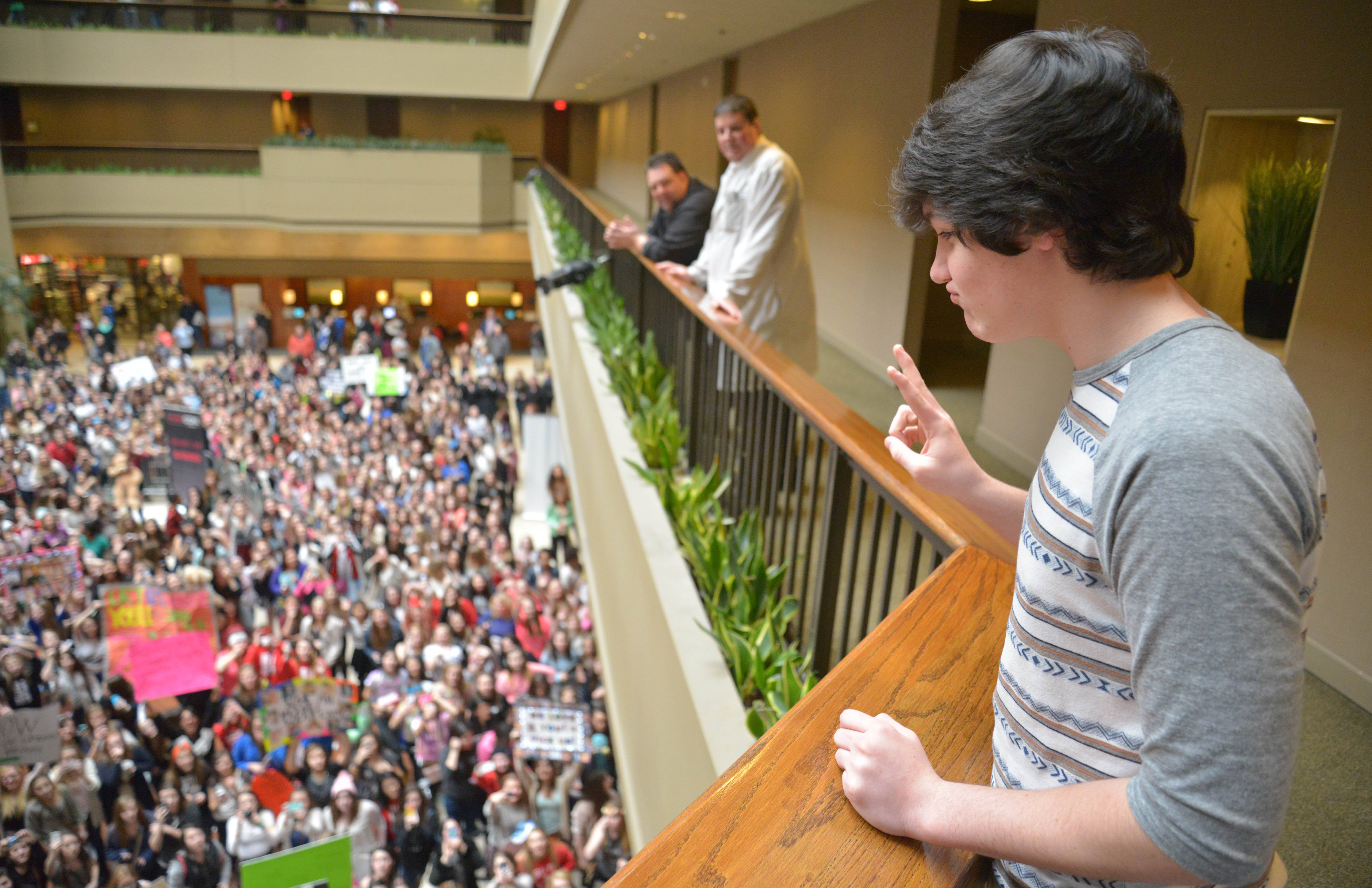 Aaron Carpenter, 15, waves to hundreds of screaming girls at MAGCON in Itasca Saturday. The teenage boys who have become social media stars with their 6-second videos on Vine were at the Westin Chicago in Itasca to meet their fans.