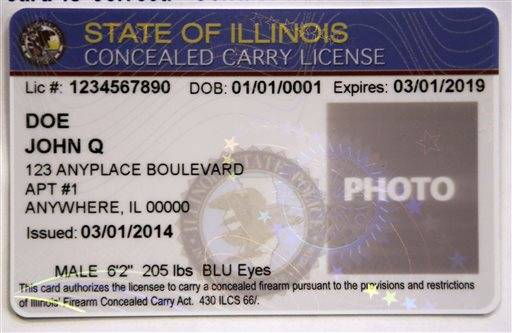 A sample of a concealed carry license is seen displayed during a news conference in Chicago where the Illinois State Police announced that 5,000 license applications have been approved and are in the process of being printed and mailed to gun owners. The red, white and blue permits are the size of a driver's license and include a photo of the license holder. They cost $150 and are good for five years.