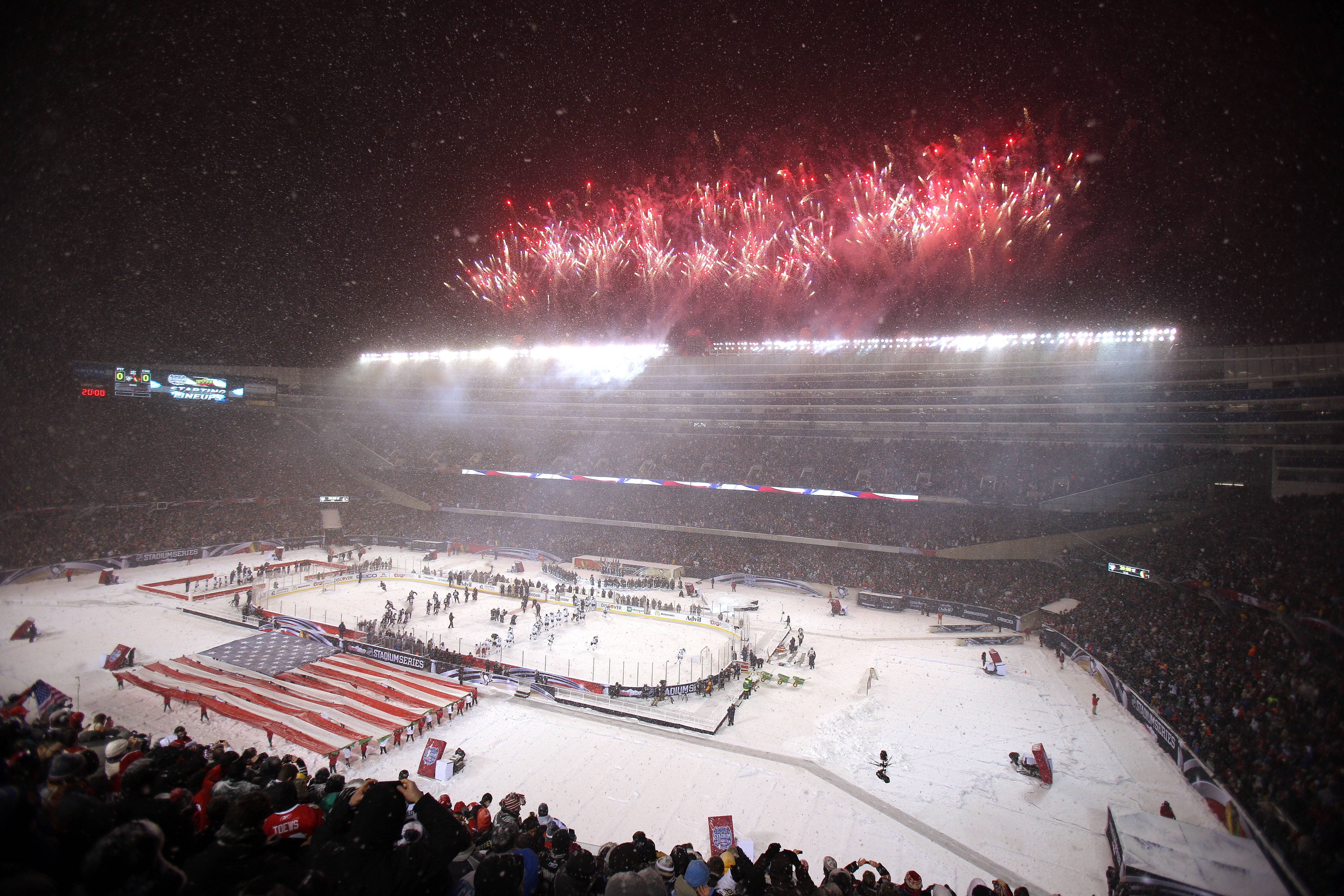 Fireworks go off after the national anthem during the NHL Stadium Series between the Blackhawks and the Penguins Saturday at Soldier Field.