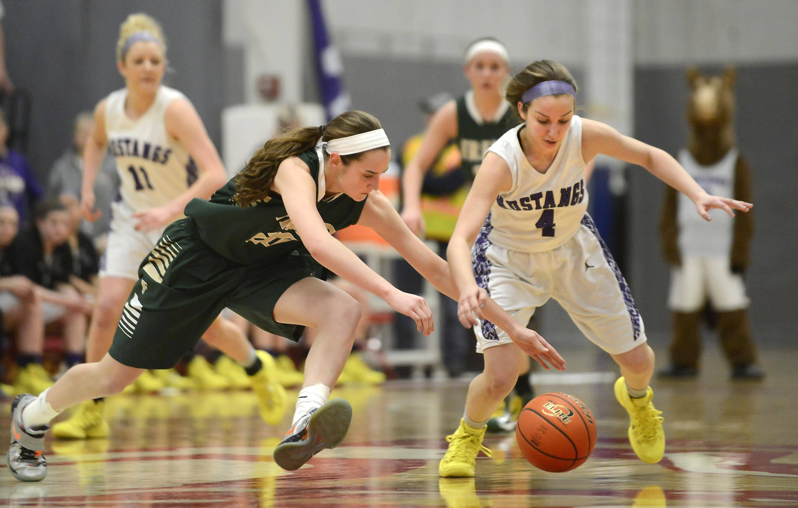 Fremd's Haley Gorecki and Rolling Meadows' Sami Kay charge for the ball after Gorecki knocked it loose Thursday in the Barrington Class 4A sectional championship game. Rolling Meadows meets New Trier at 8 p.m. Monday in supersectional play at Hoffman Estates with a final four berth at stake.