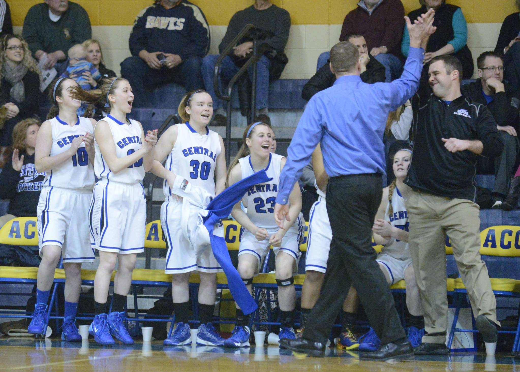 Burlington Central girls basketball coach Mark Smith high-fives assistant coach Kyle Molik near the end of the Rockets' regional final win over St. Edward.