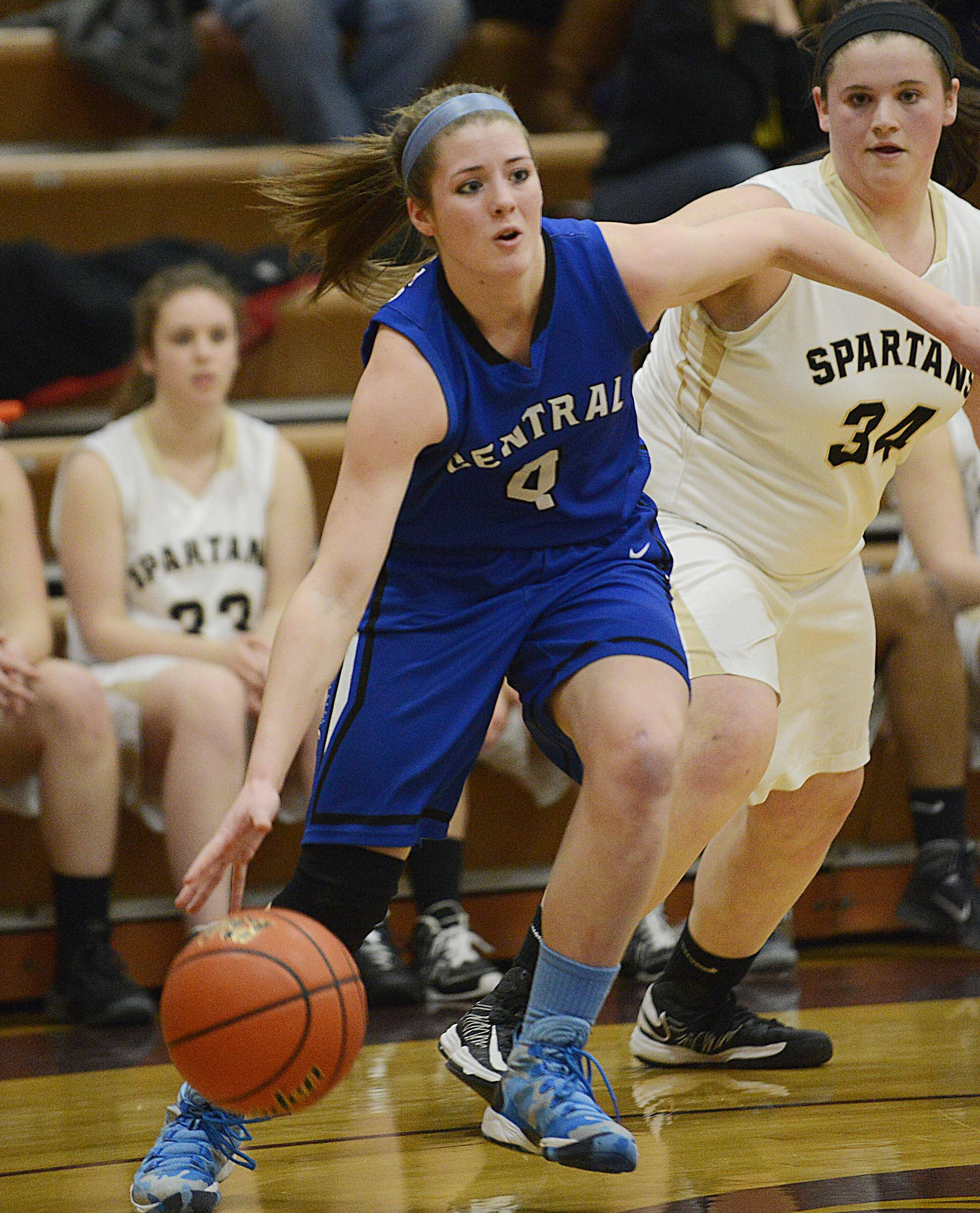 Burlington Central sophomore Kayla Ross (4) drives to the basket against Sycamore in the semifinals of the Class 3A Belvidere sectional.