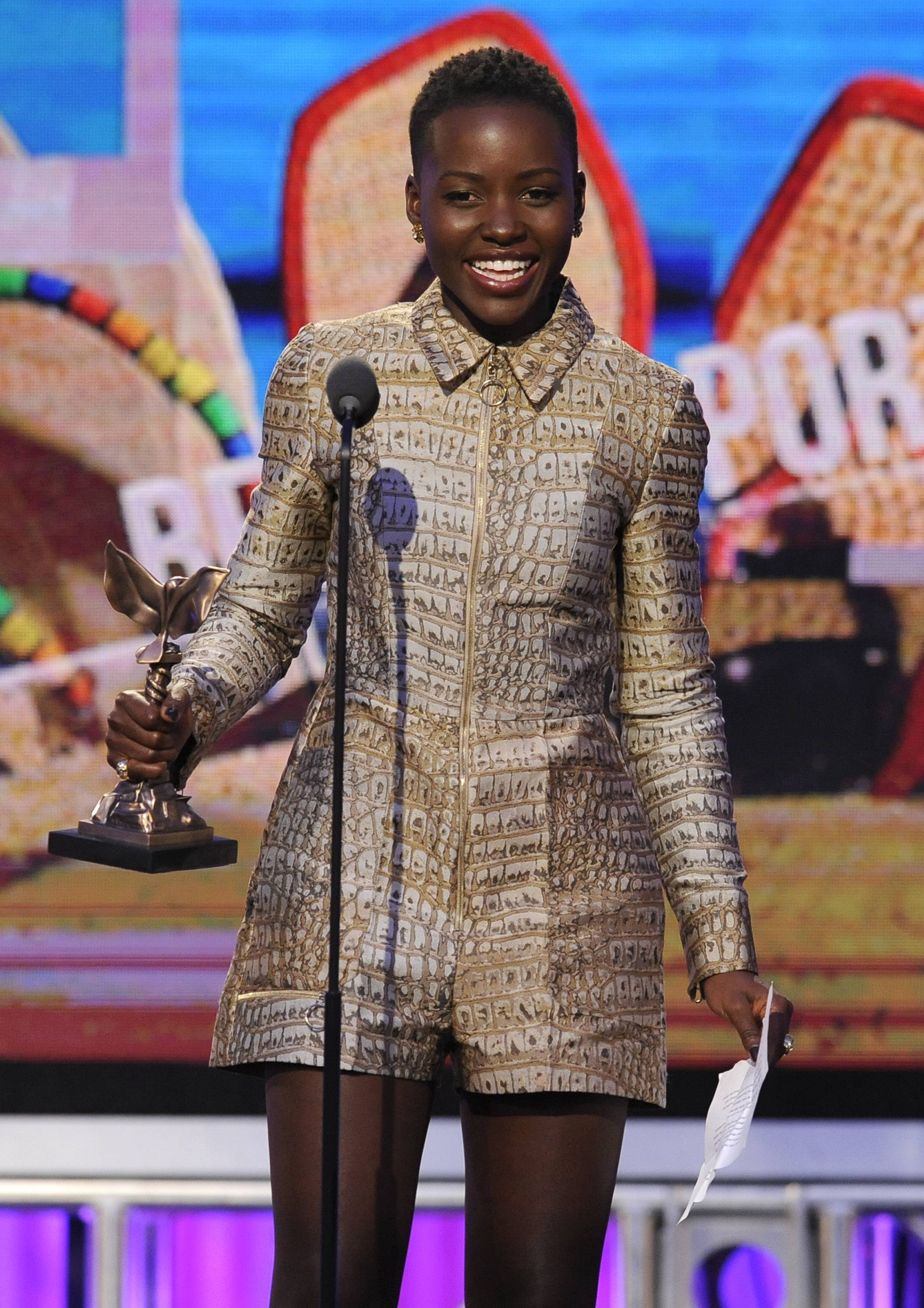 Lupita Nyong'o accepts the award for best supporting female on stage at the 2014 Film Independent Spirit Awards, on Saturday in Santa Monica, Calif.