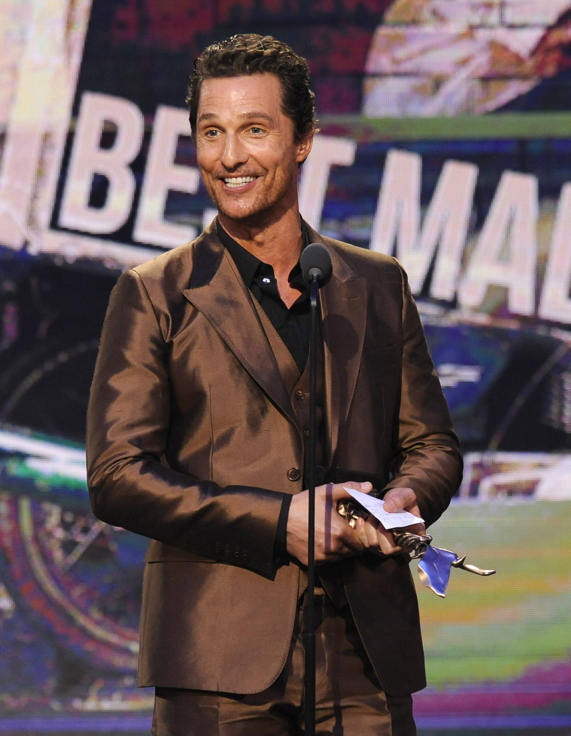 "Matthew McConaughey accepts the award for best male lead for ""Dallas Buyers Club"" on stage at the 2014 Film Independent Spirit Awards, on Saturday in Santa Monica, Calif."
