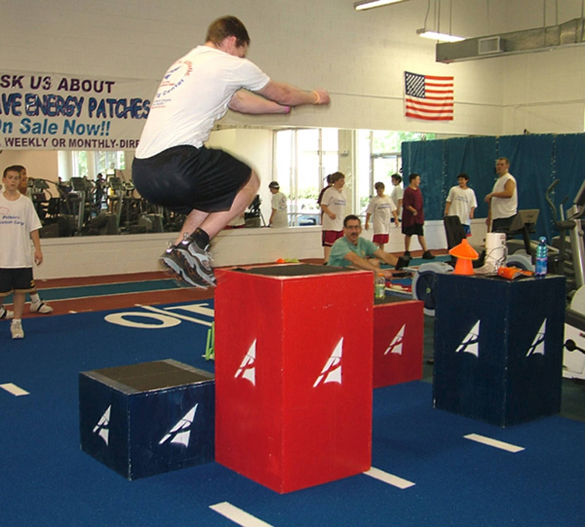 TJ Burns practicing box jumps; hurdles, box jumps and other plyometric exercises are standard for bobsled training.
