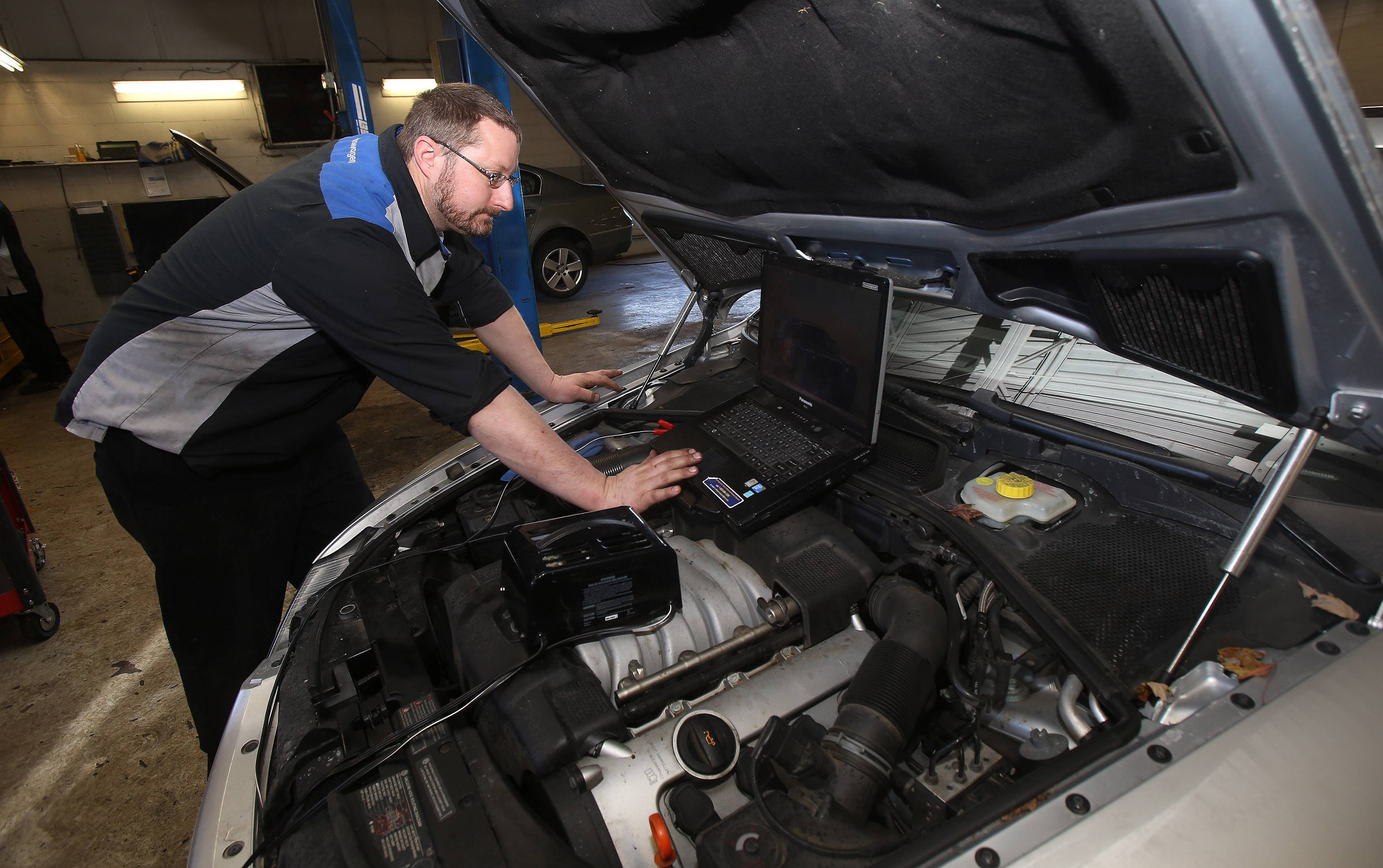 Master technician Dave Wiegel checks the diagnostics on a car in the service department of Muller Auto Group in Highland Park.