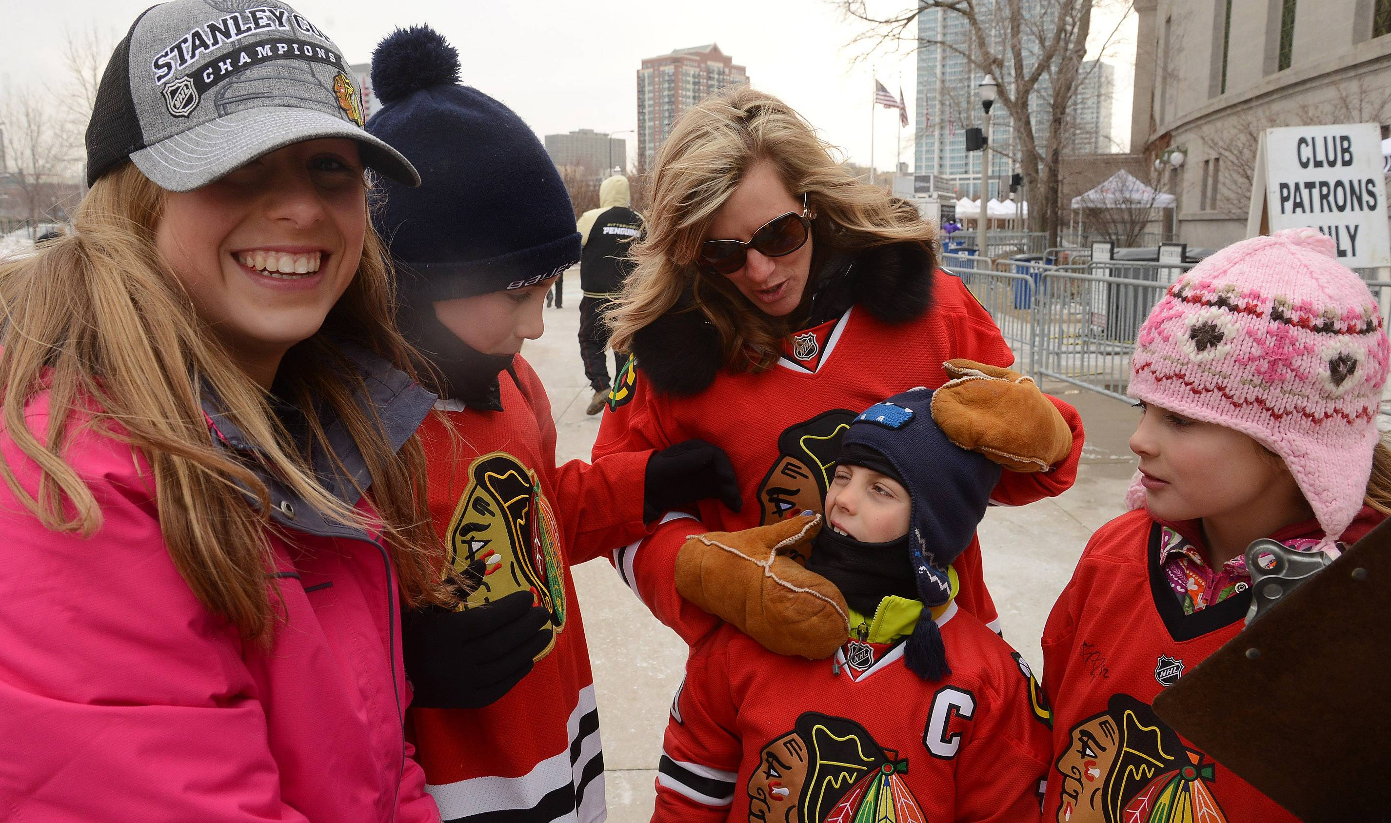 Leanna Van Ness with Ella, Lukas, Devan and Hannah Van Ness, all from Barrington try to stay warm before Saturday's Coors Light Stadium Series game at Soldier Field between the Blackhawks and Pittsburgh Penguins.