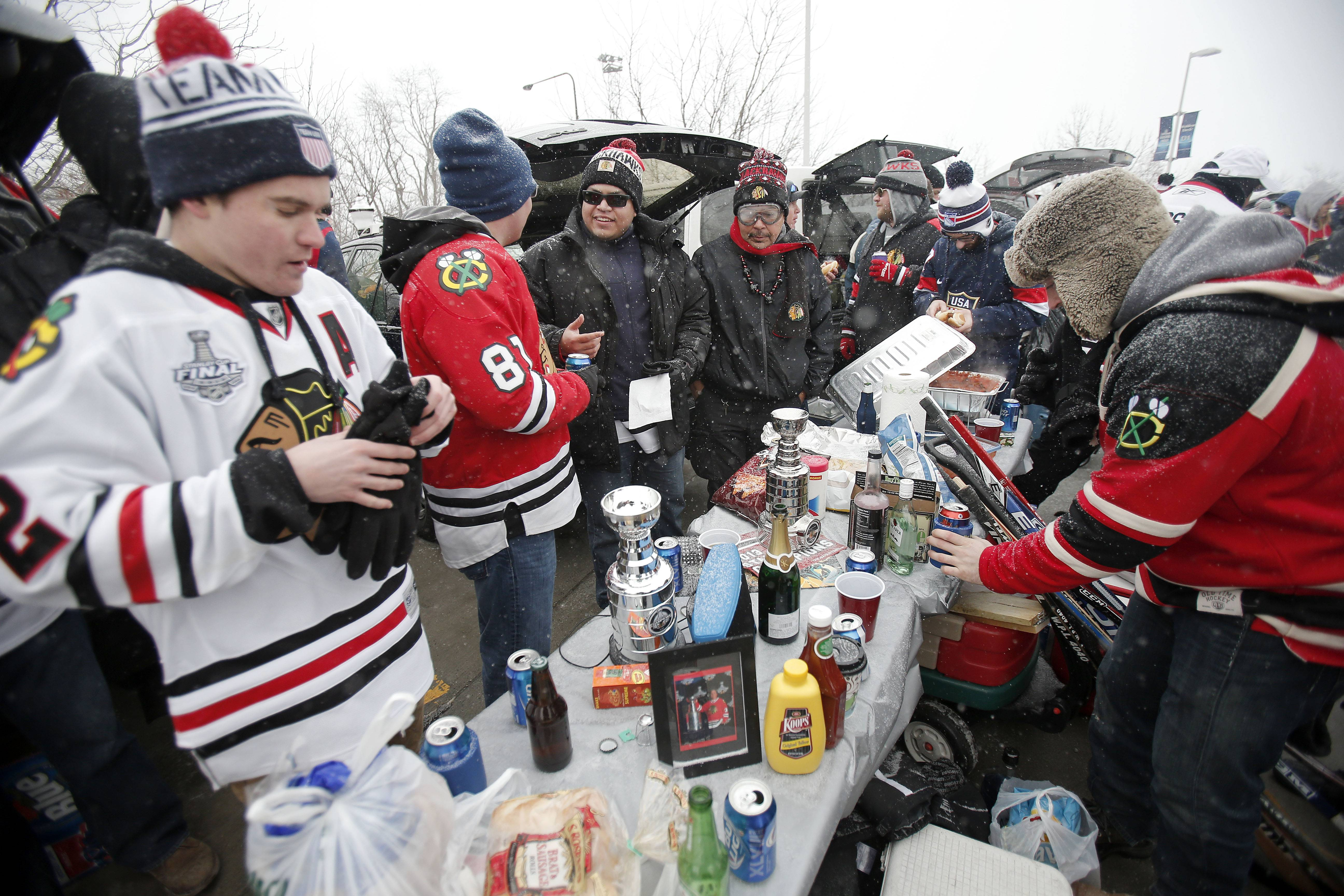 Tailgaters party before the Blackhawks vs Penguins NHL Stadium Series Saturday at Soldier Field.