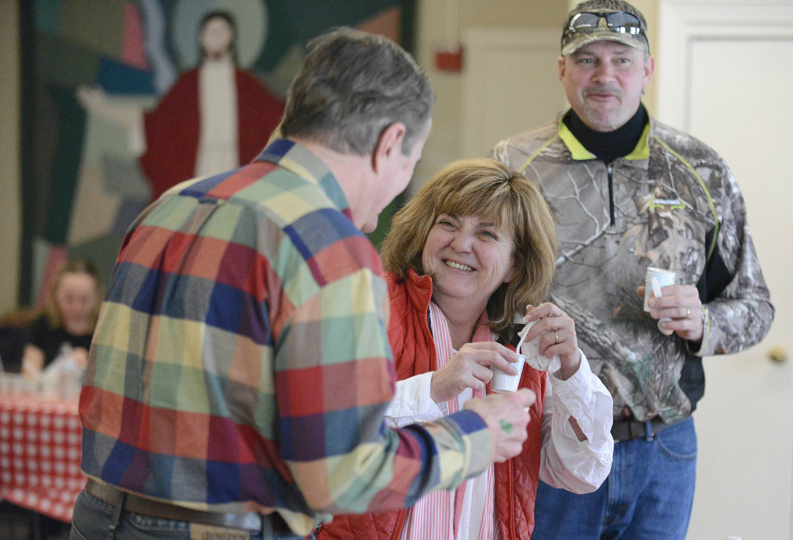 Josephine Zema of St. Charles jokes with Dick Hattan of Geneva while they sample chili by contestant Dallas Heikkinen at St. Charles Episcopal Church's chili cook-off on Saturday. Zema's friend, Halbe Wynstra of Capron, right, and his wife, Robyn attended for the fun. Zema, Hattan and Heikkinen are all parishioners at the church.
