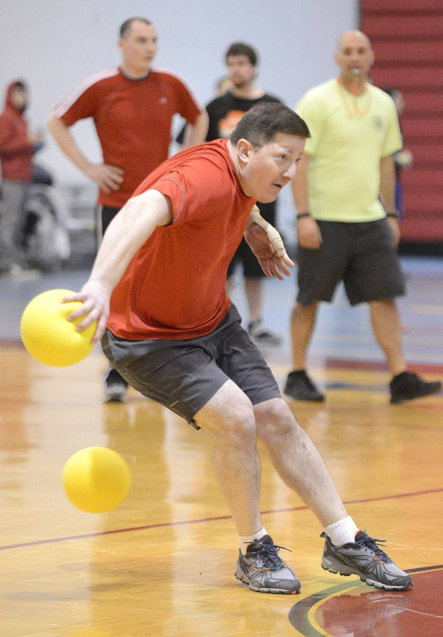 Mike Grezenko of Lombard and team PA Crimson twists to avoid being hit but gets nailed seconds later during a game at Carpentersville IAFF Local 4790's fourth annual dodgeball tournament at Dundee-Crown High School in Carpentersville on Saturday.